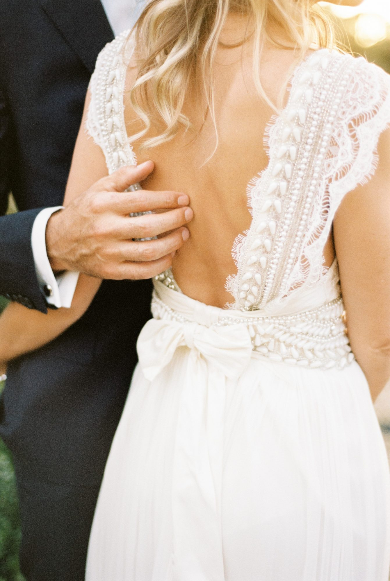 A Bride with an Open-Back Wedding Dress with Embellishments