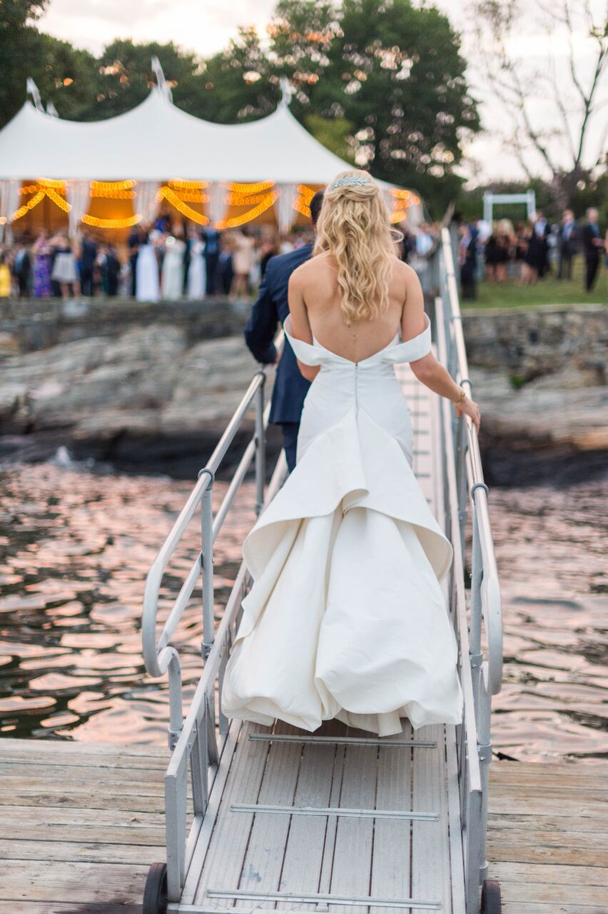 A Bride with an Off-the-Shoulder Open-Back Wedding Dress