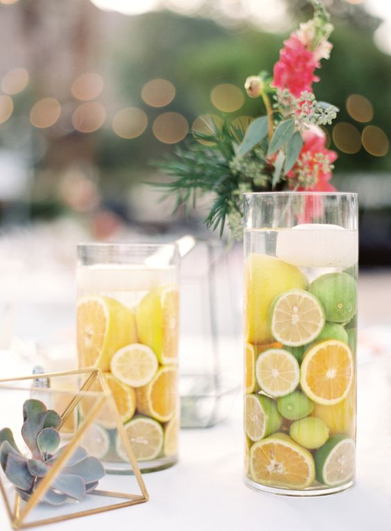 vases filled with citrus fruits