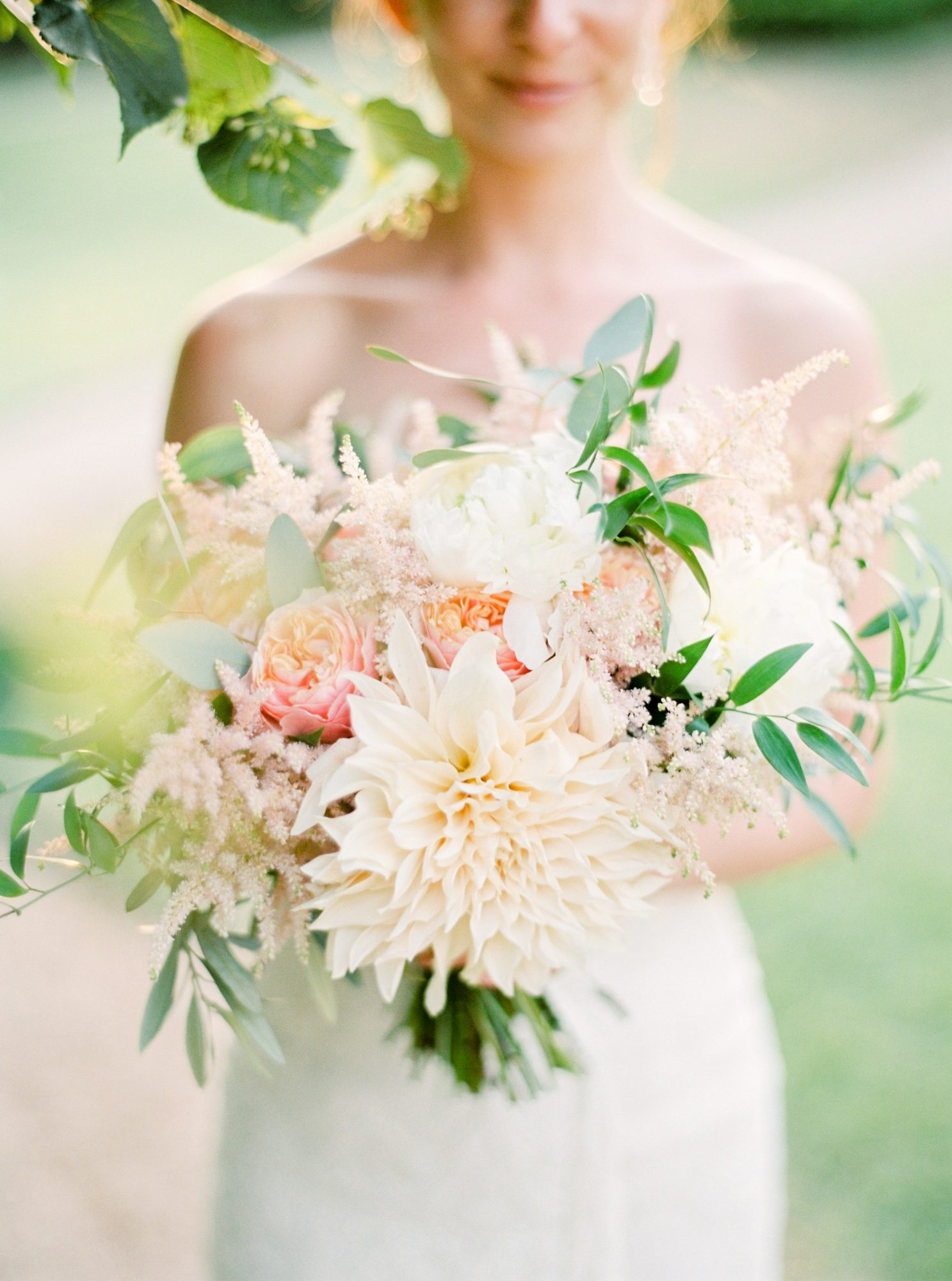Pink and peach dahlia wedding bouquet