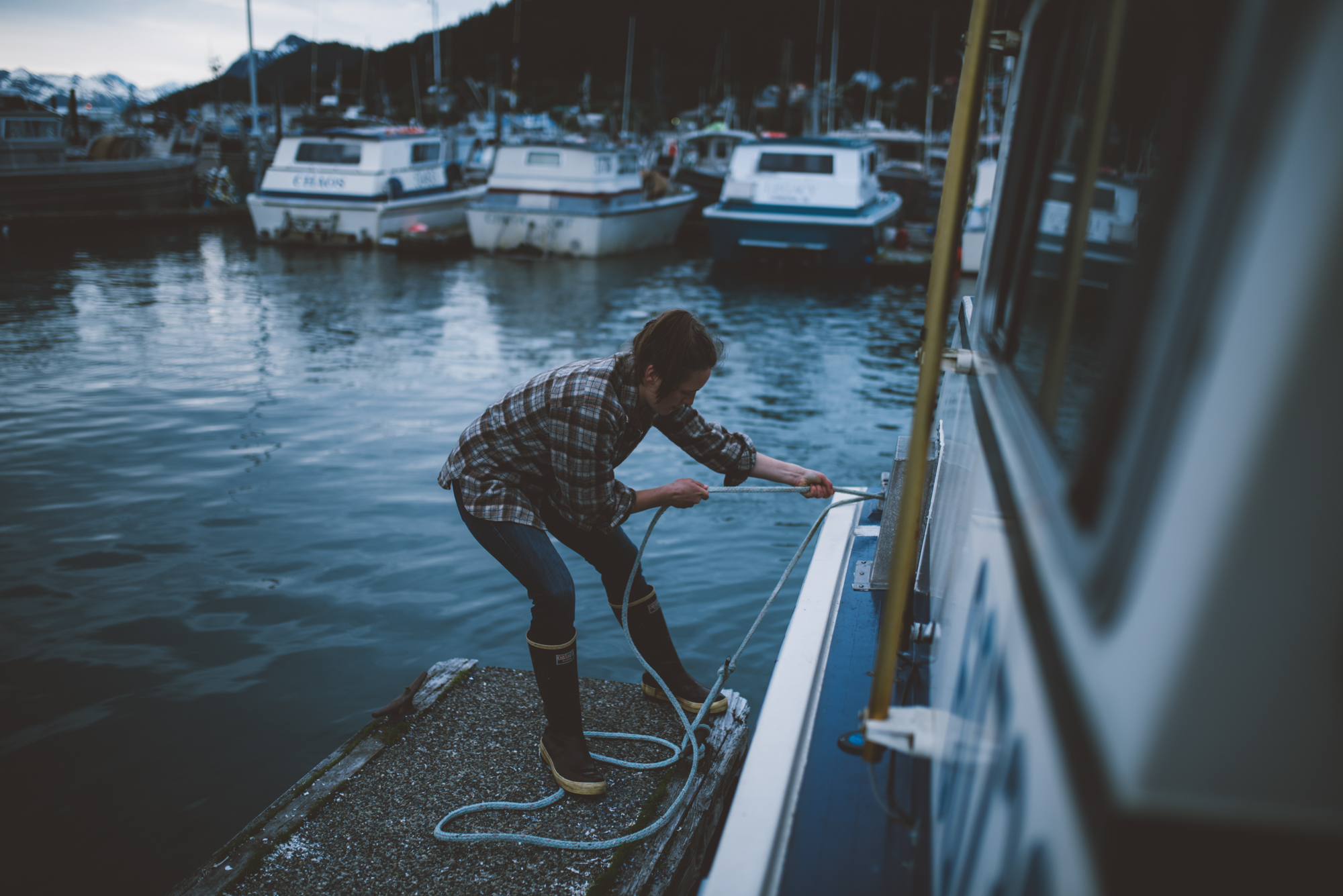 nelly hand tying off boat in harbor