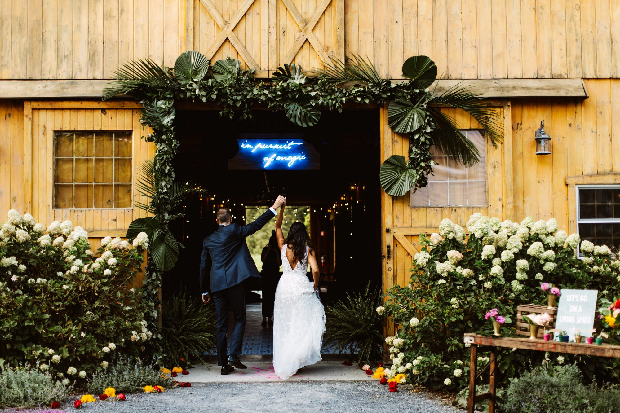 in pursuit of magic neon sign with couple making reception entrance