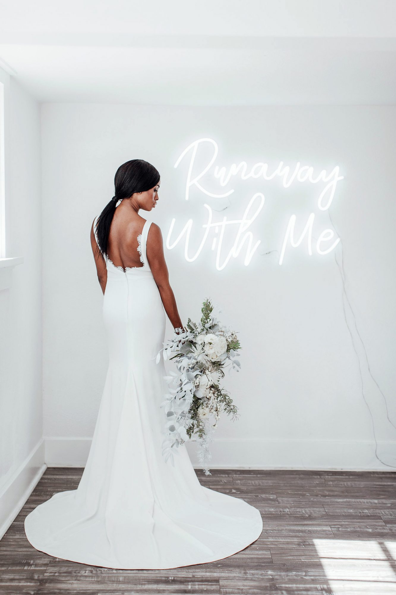 runaway with me neon sign with bride and bouquet