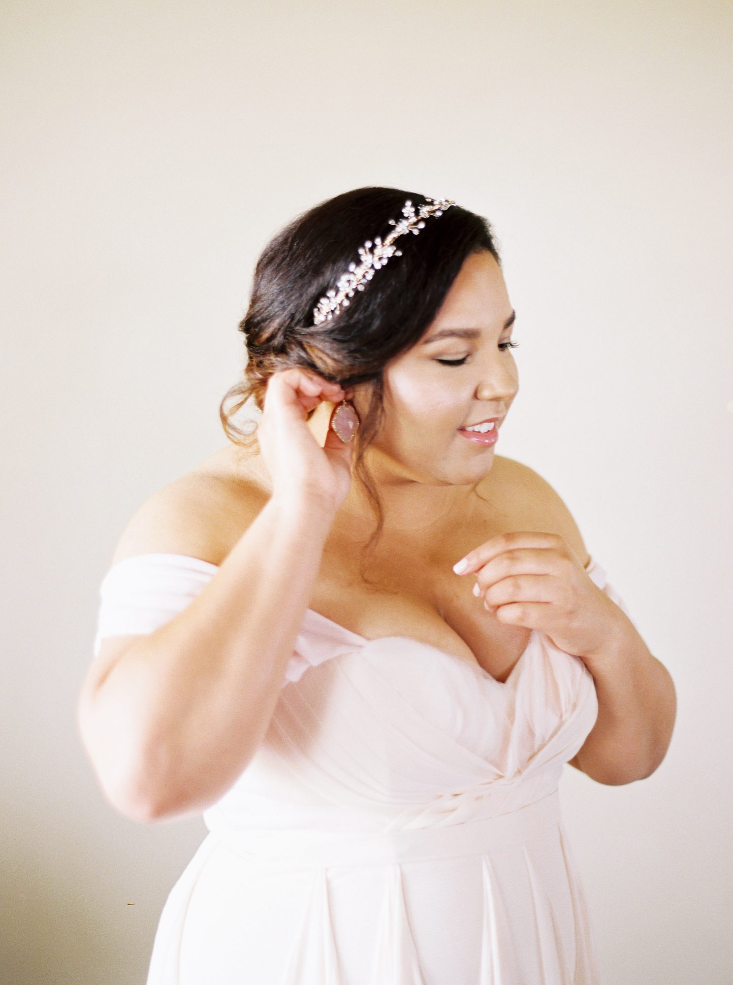 bride putting earring on