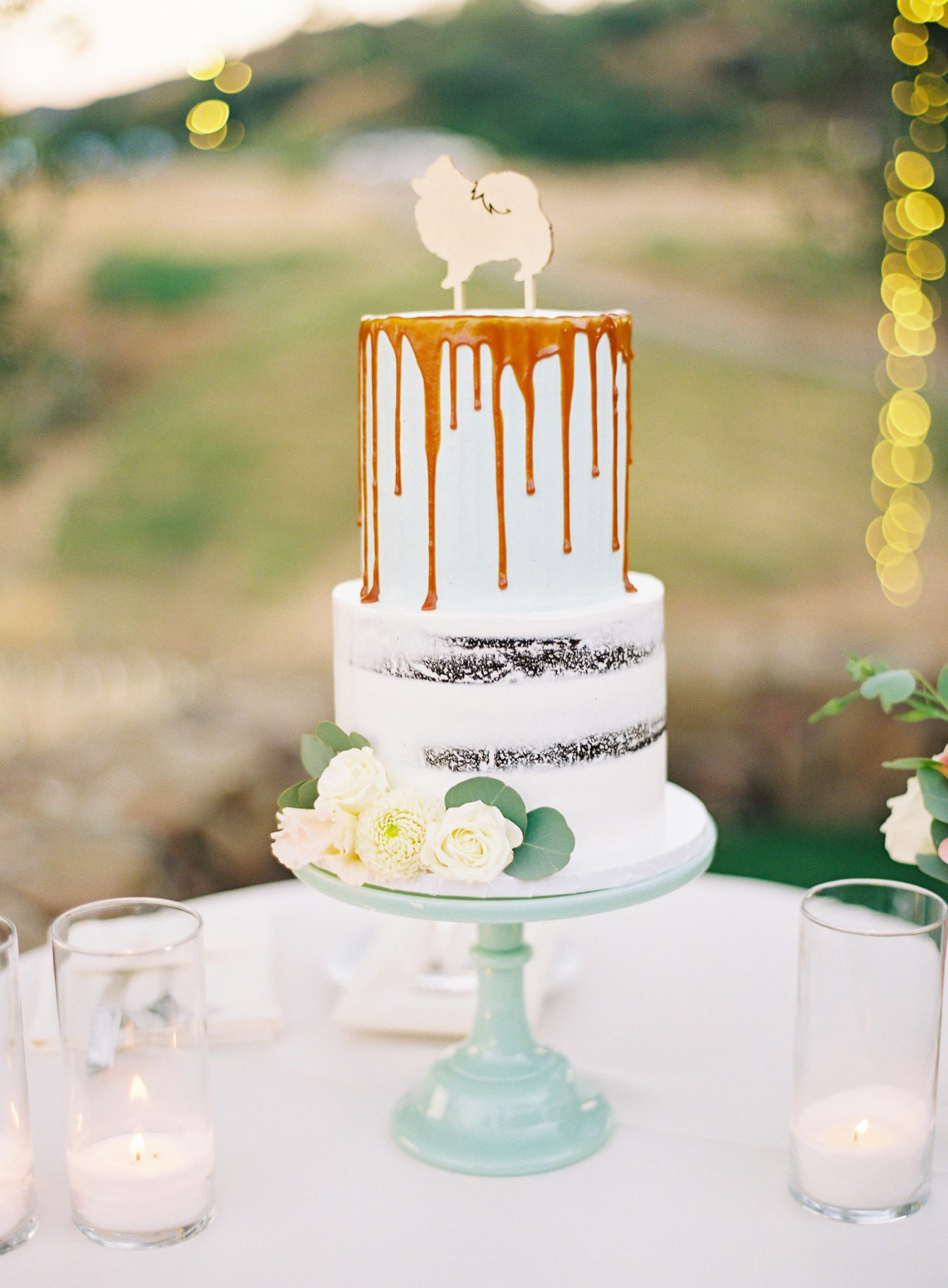white cake with dog topper