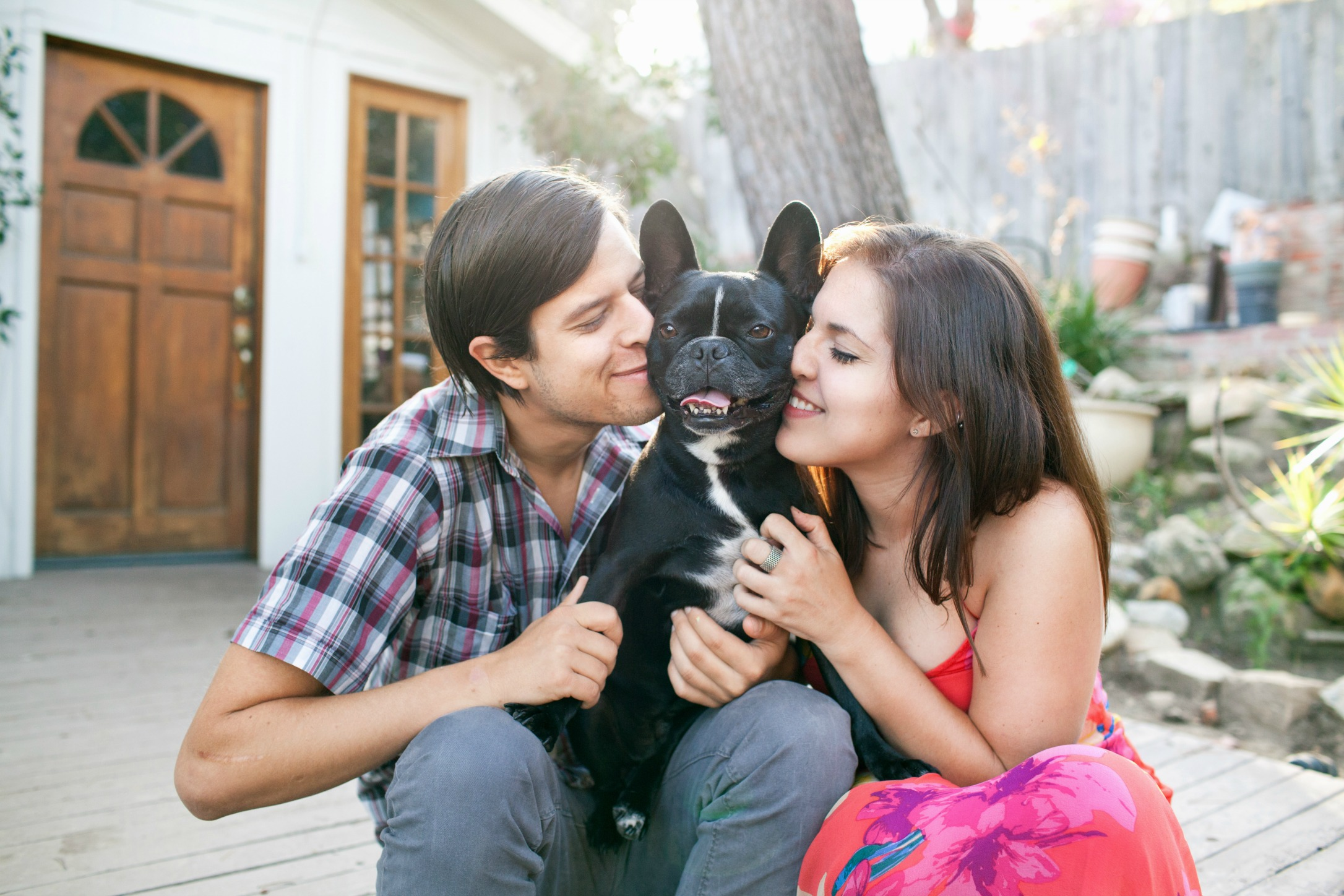 young couple with French Bulldog