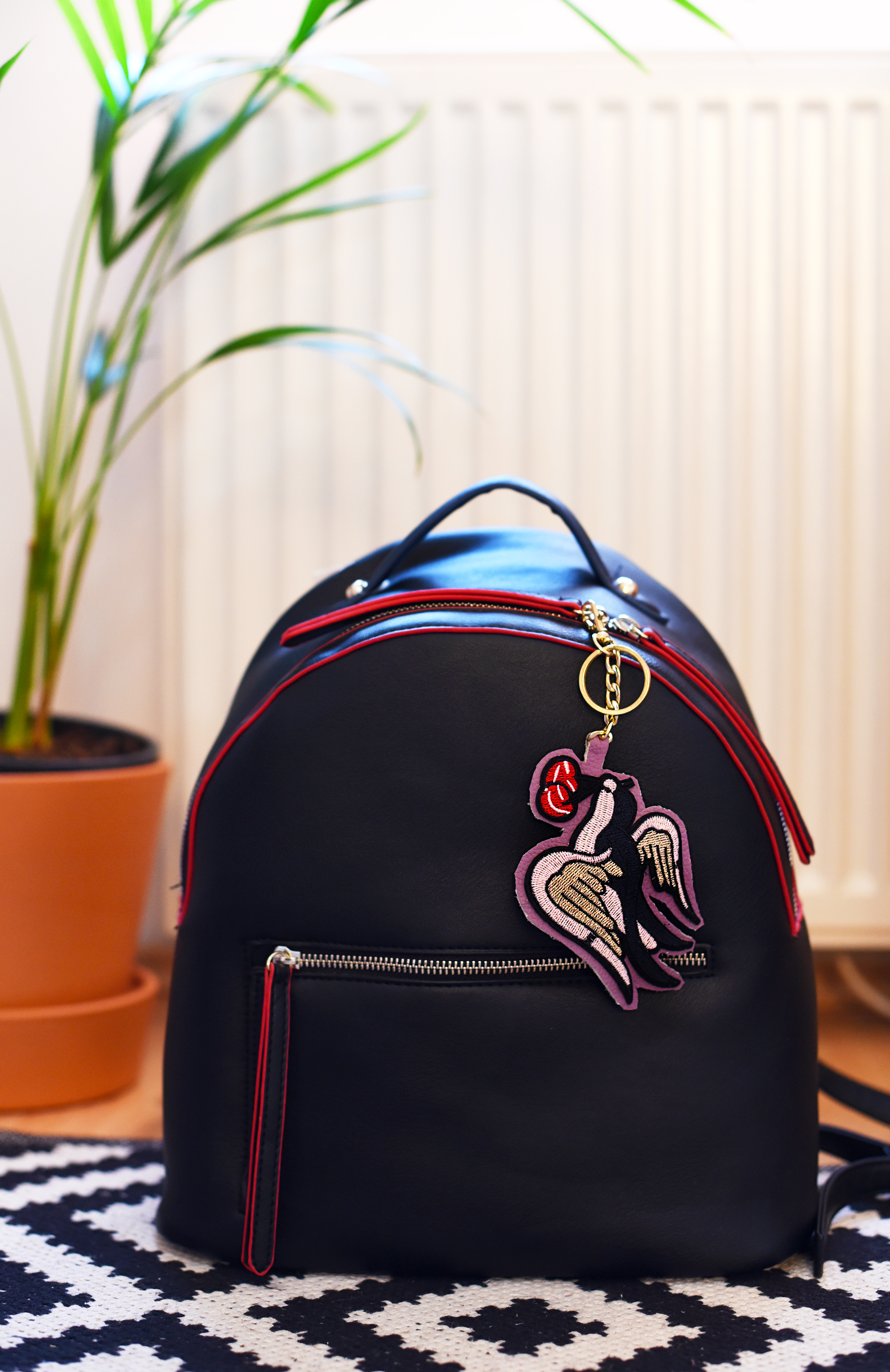 patch-leather-keychain-bird-on-backpack