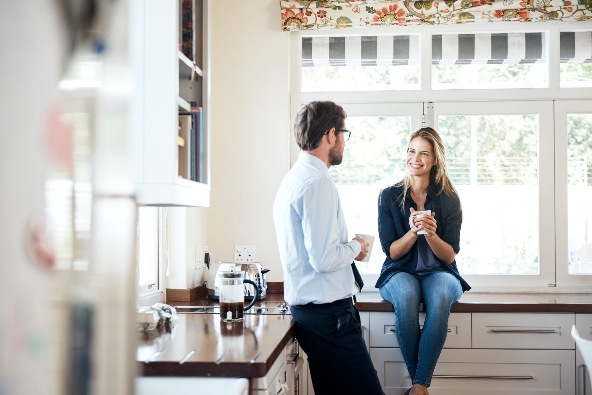 Couple at Home in the Kitchen drinking coffee