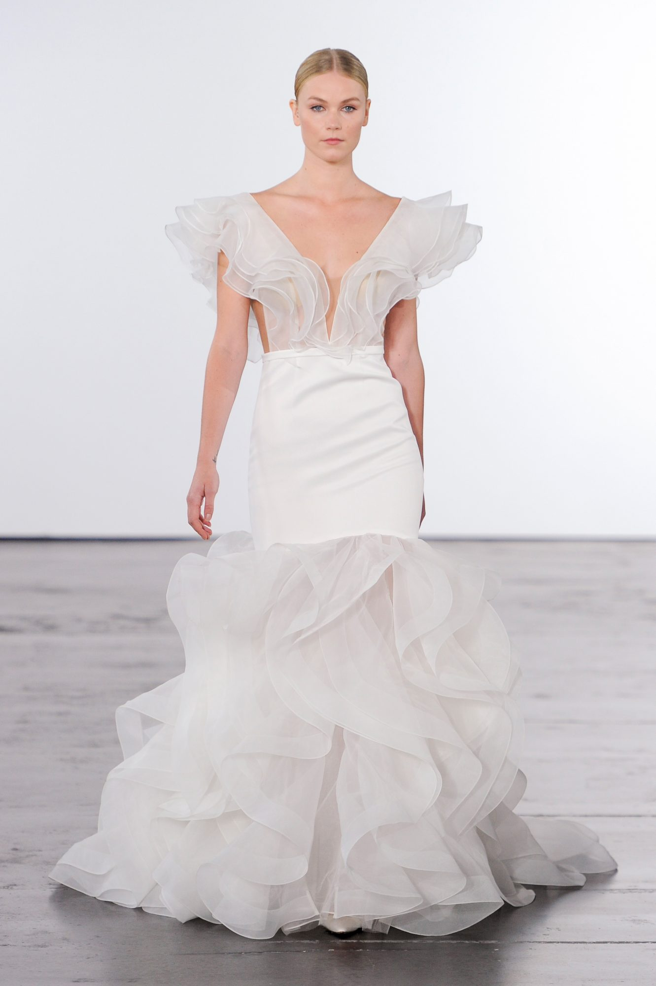 dennis basso trumpet wedding dress with flowing sheer layers fall 2018
