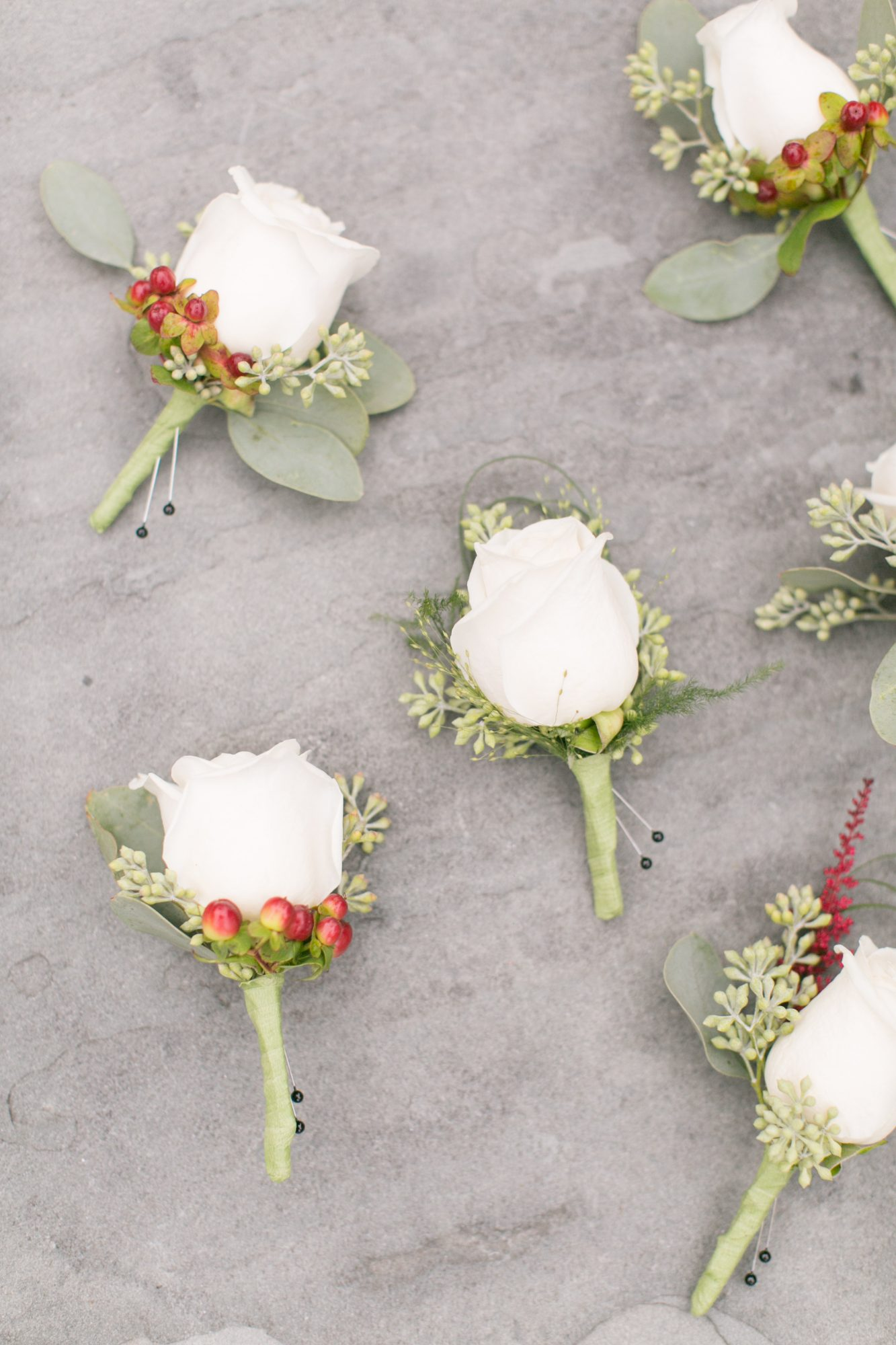 white boutonnieres with berries