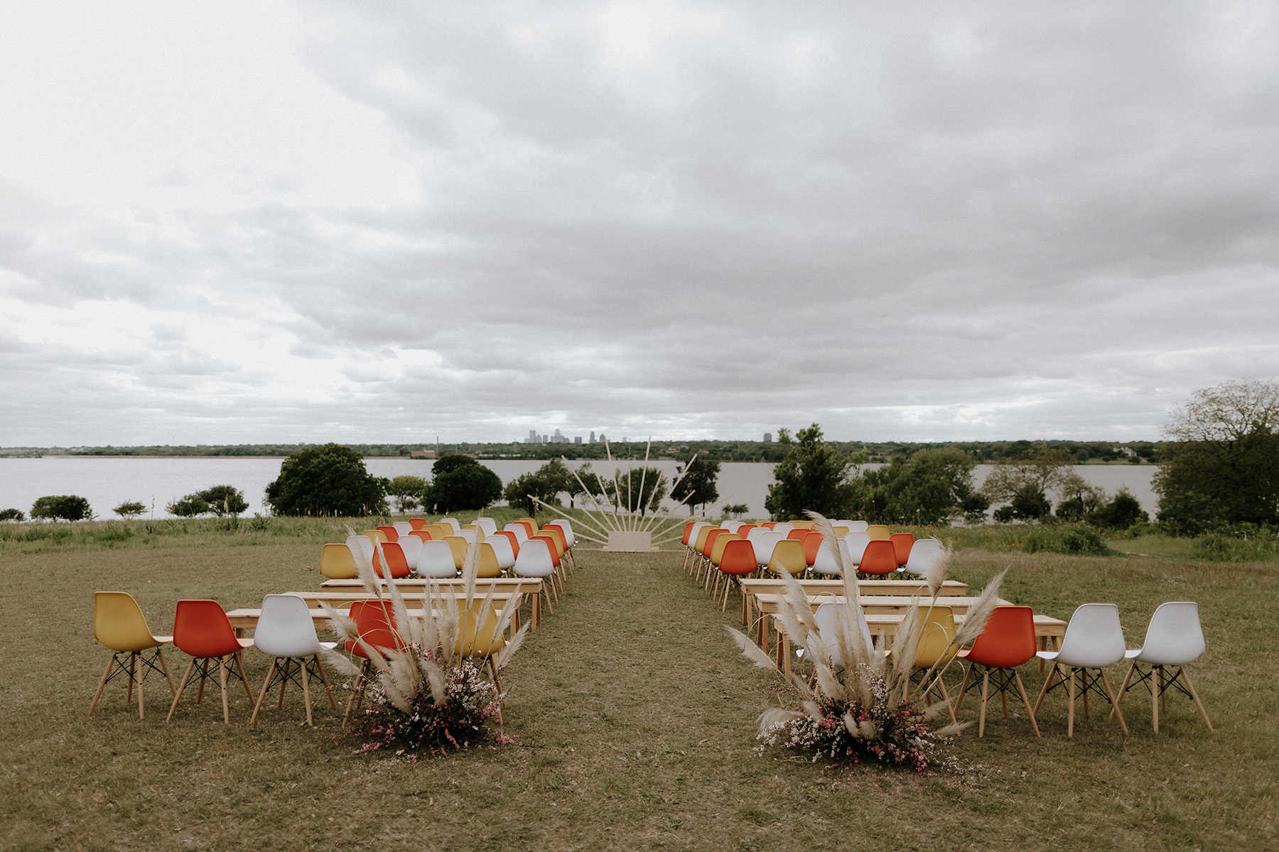 wedding ceremony with colorful chairs