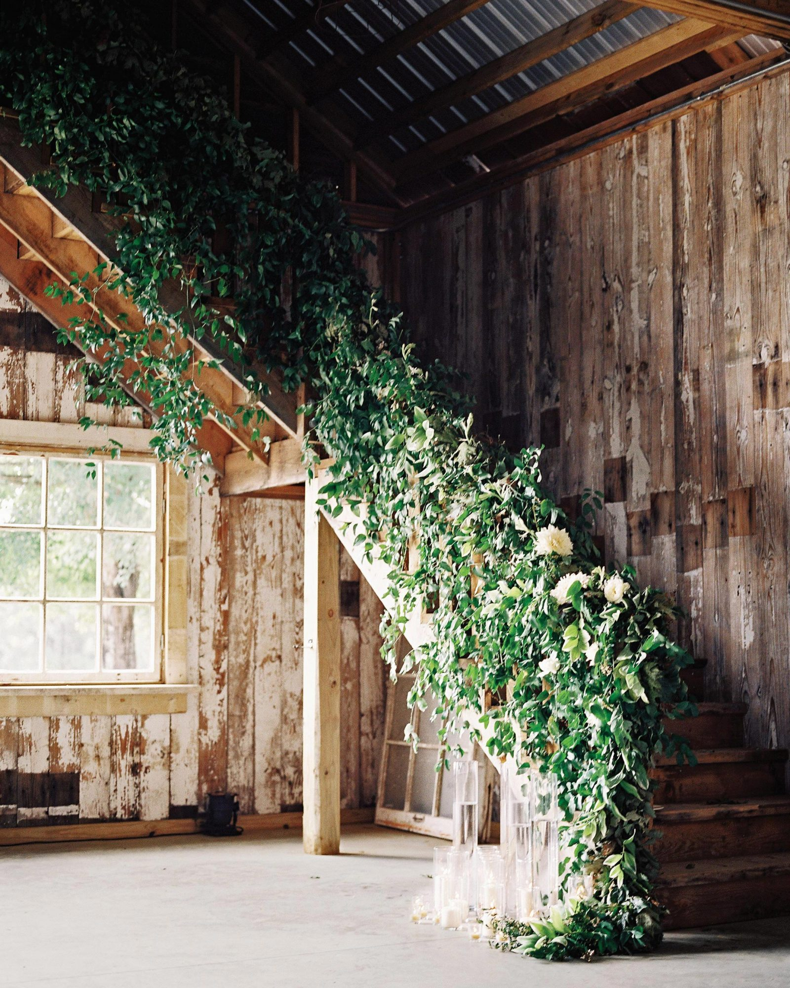 stephanie-mike-wedding-north-carolina-barn-staircase-floral-garland-11-s112048.jpg