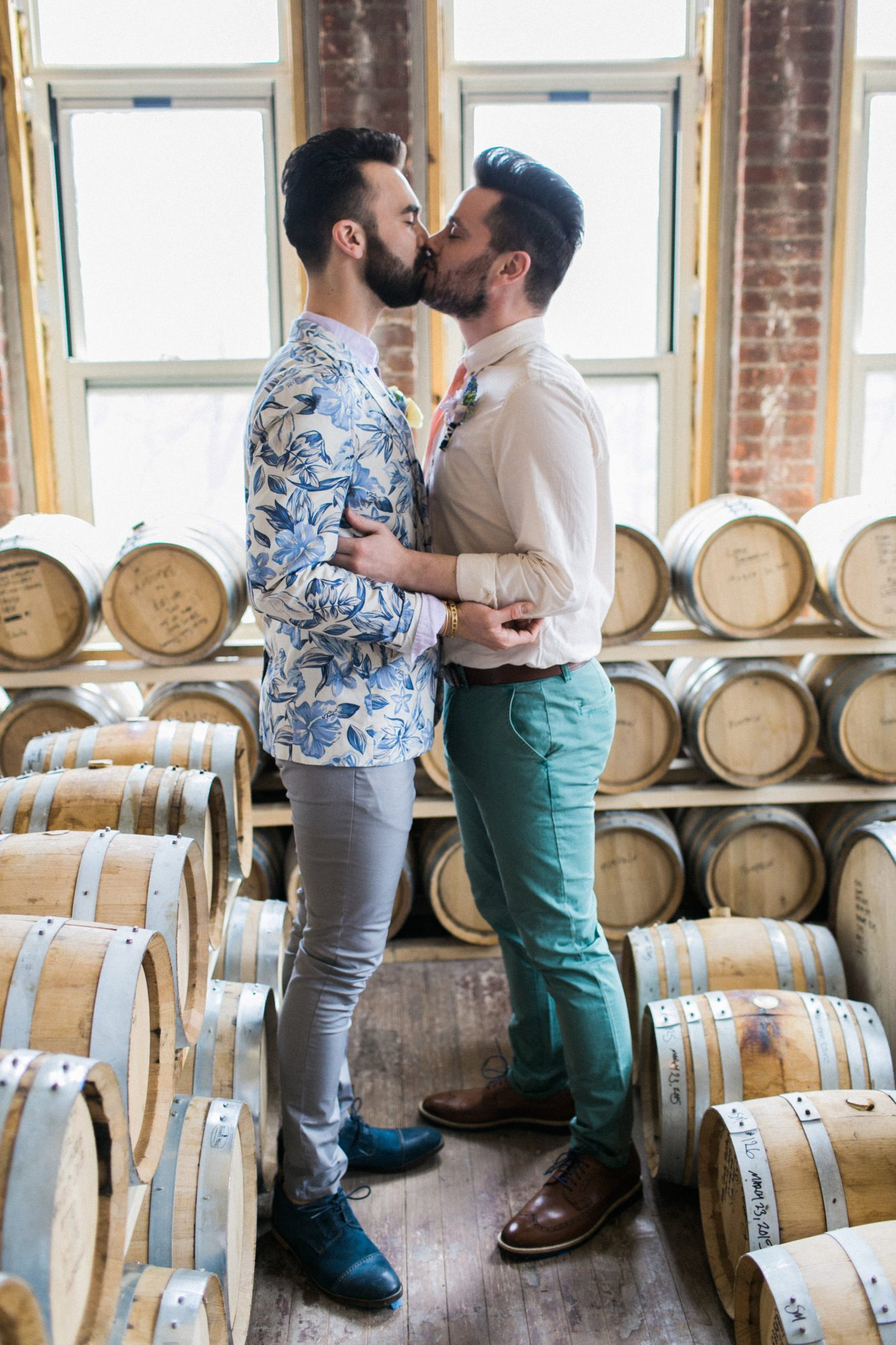 two grooms kissing
