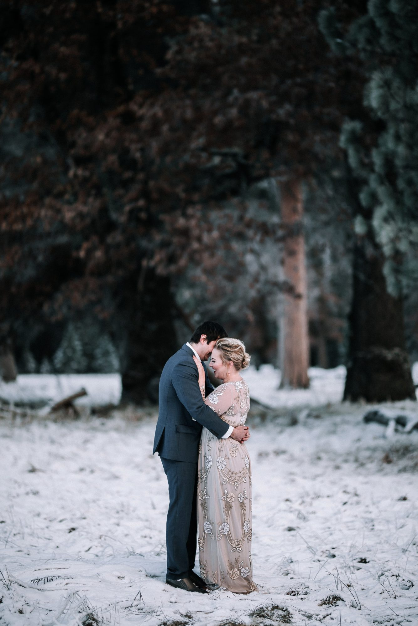 couple in woods with snow
