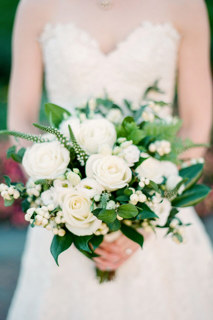 white roses berries bouquet