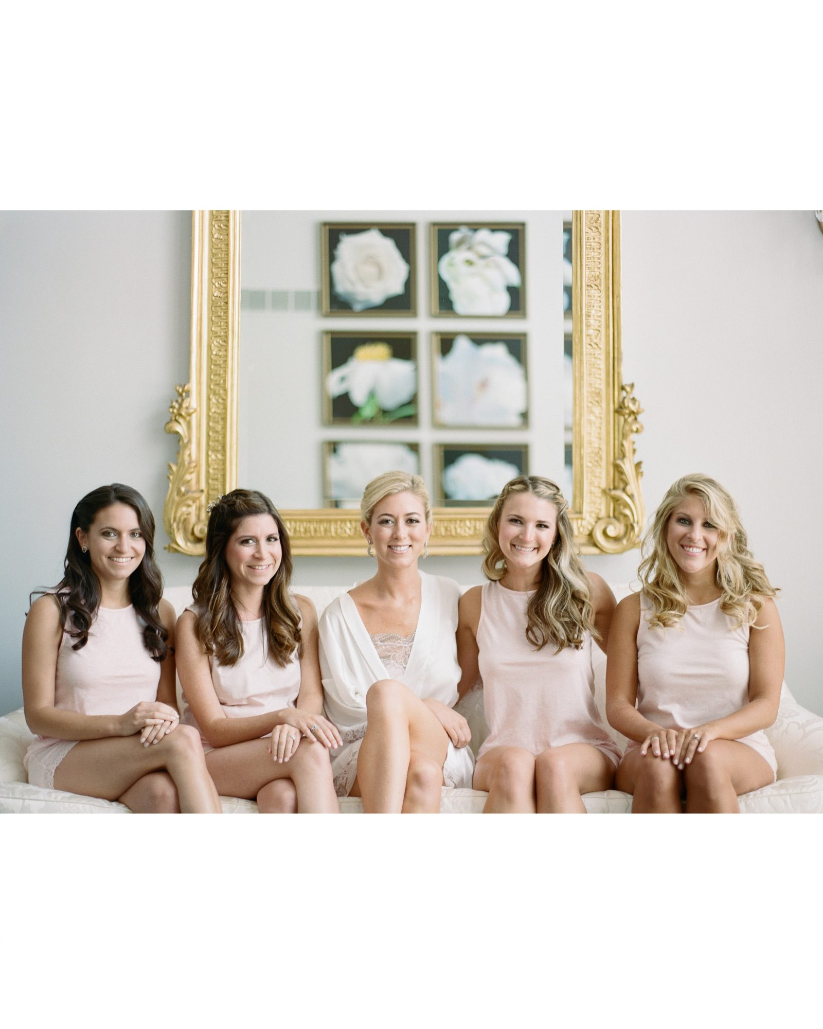 bridesmaids and bride on chair