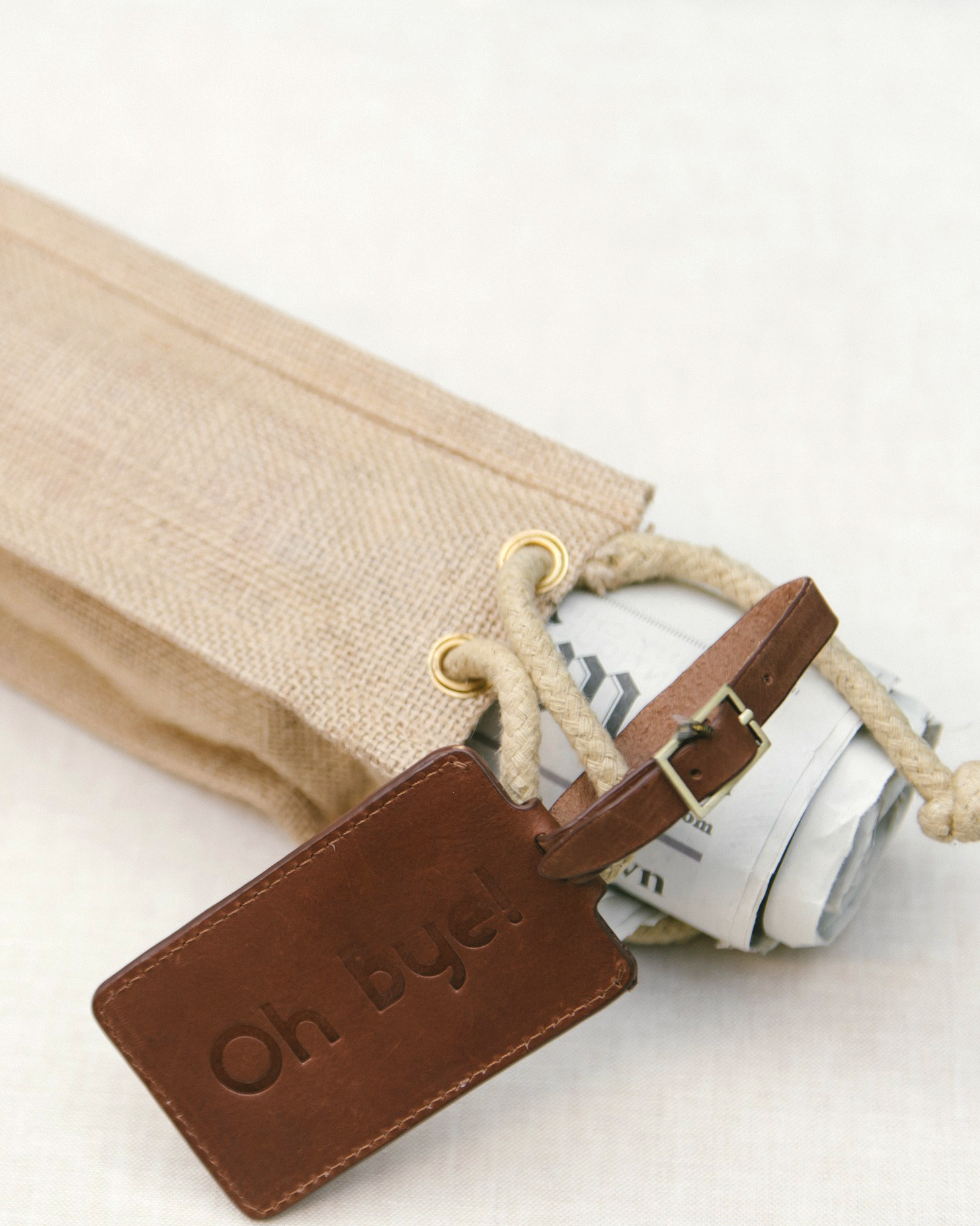"Brunch favors included ""Oh bye"" custom leather luggage tags (a riff on their ""Oh hi,"" Ojai-inspired welcome versions), and newspapers in burlap bags for the plane ride home. The accompanying note read: ""Safe Travels. Love, Mr. and Mrs. Katz."""