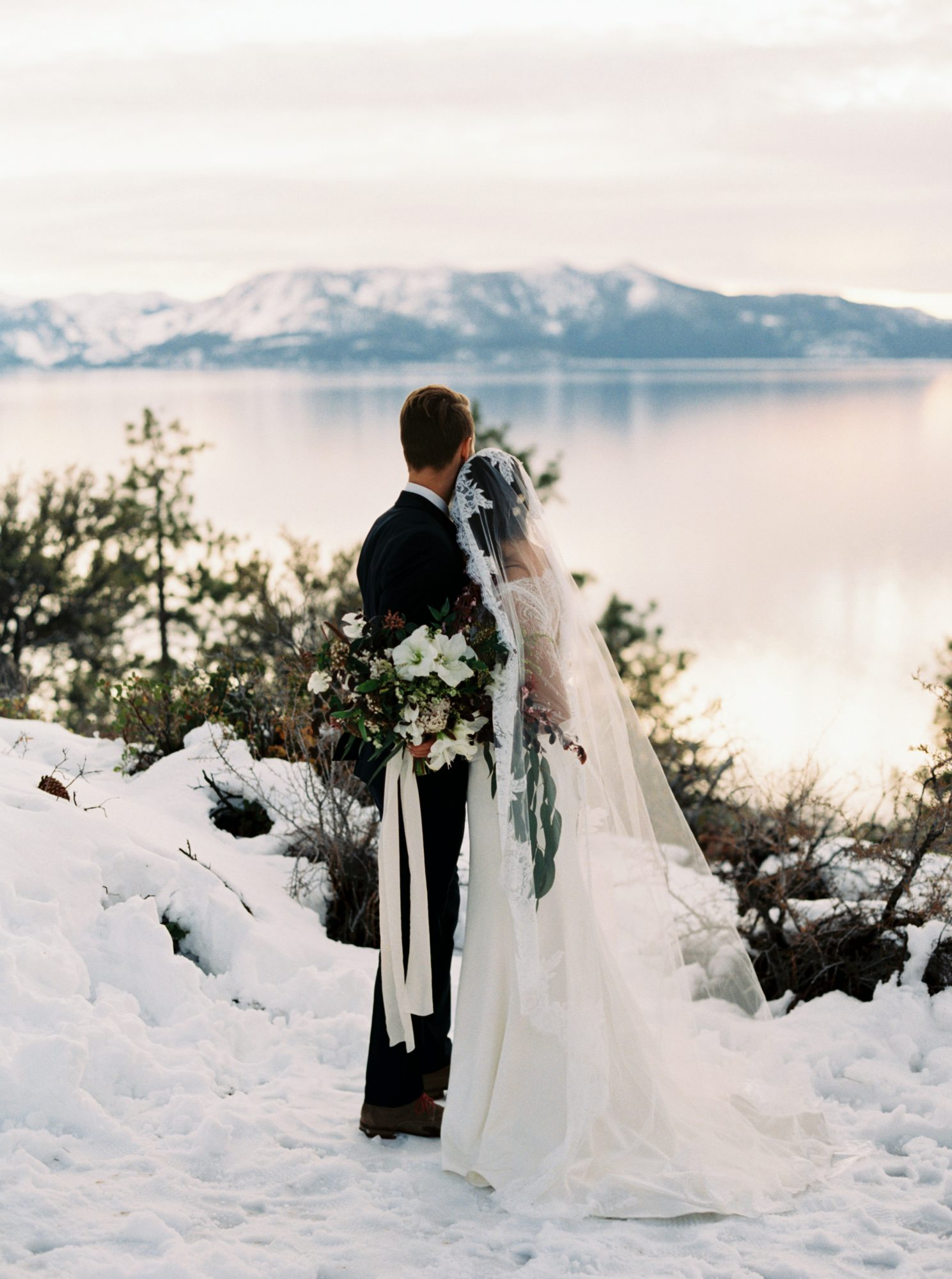 couple looking out at lake