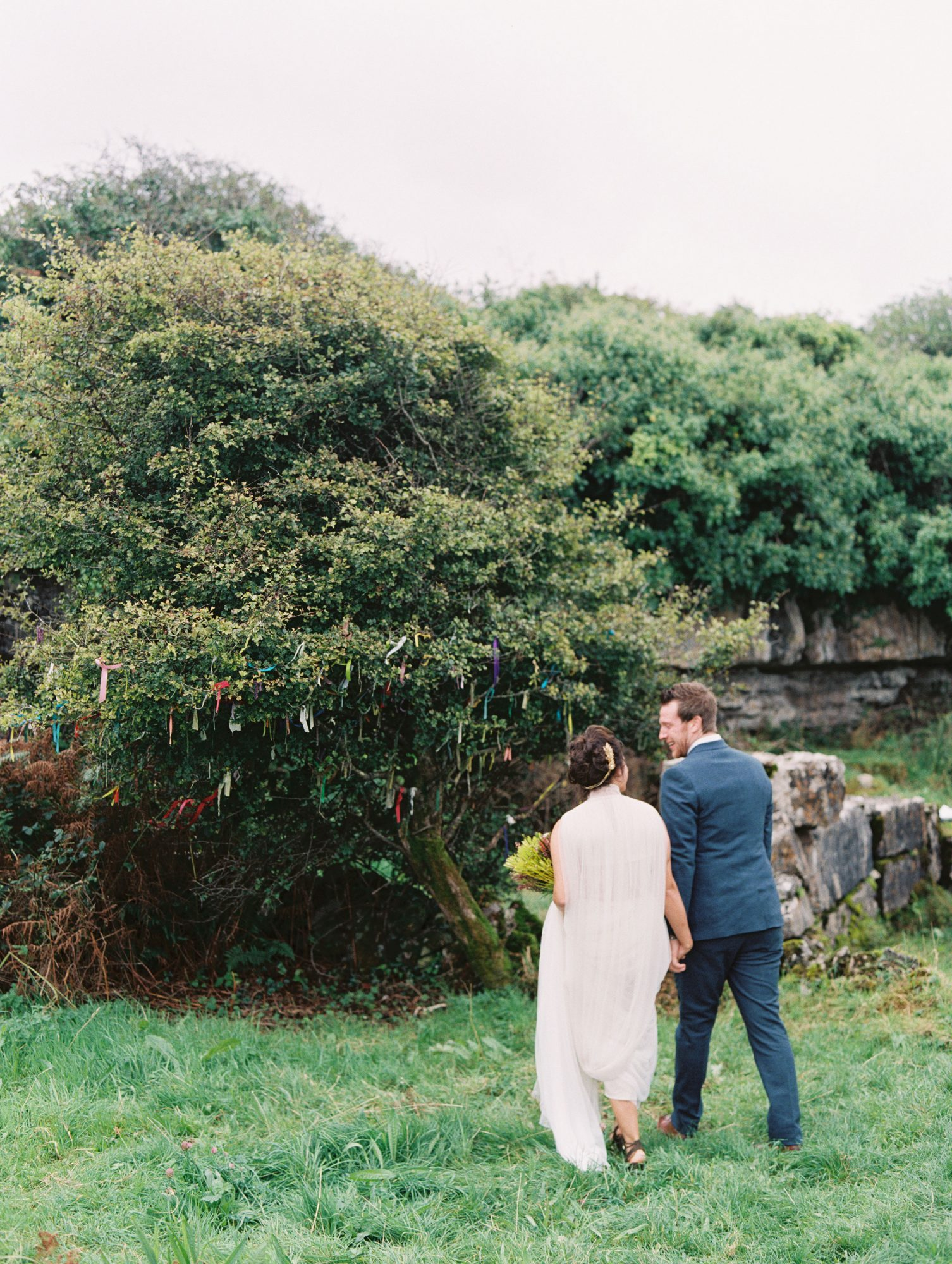 bride and groom walking bush