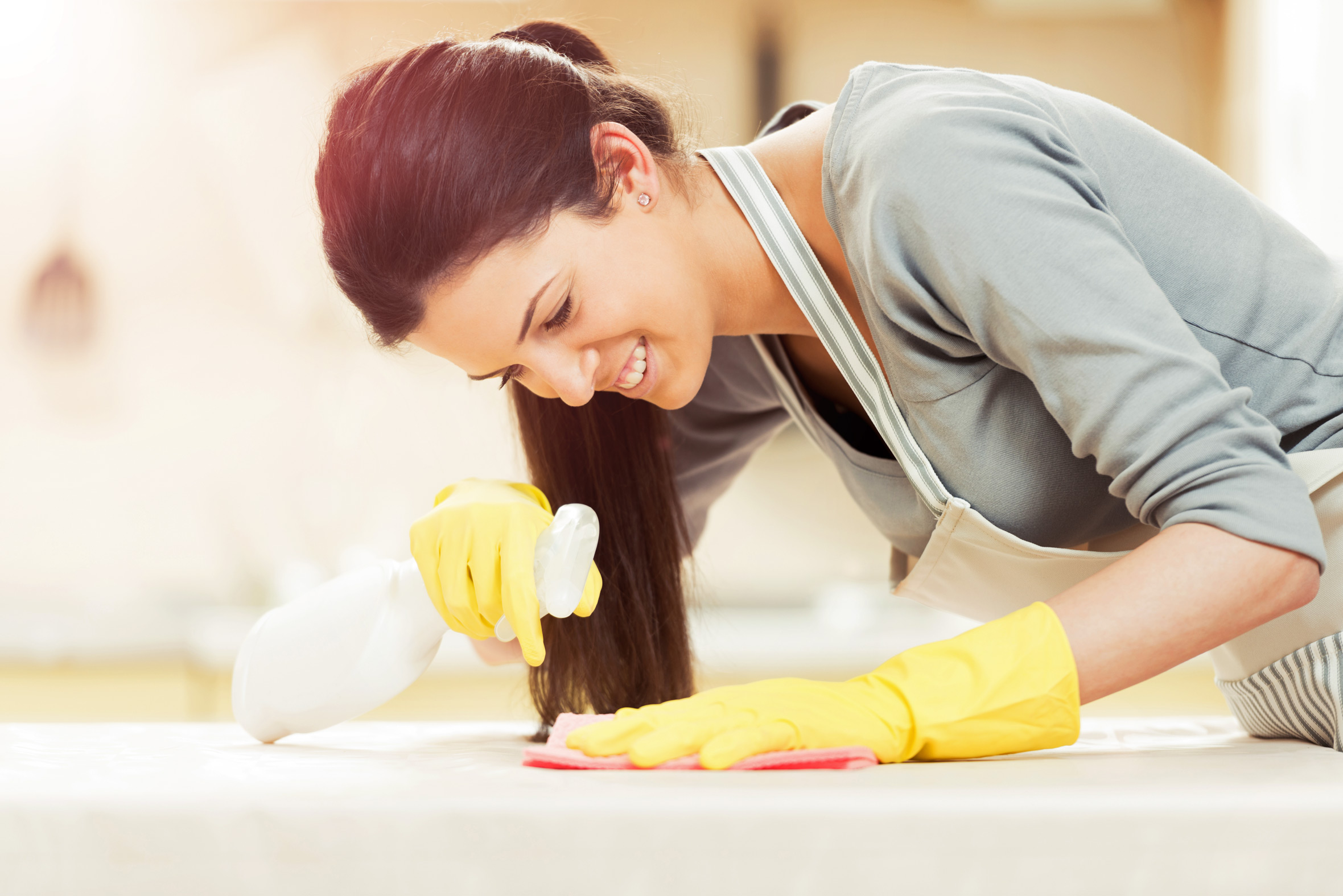 woman cleaning bleach