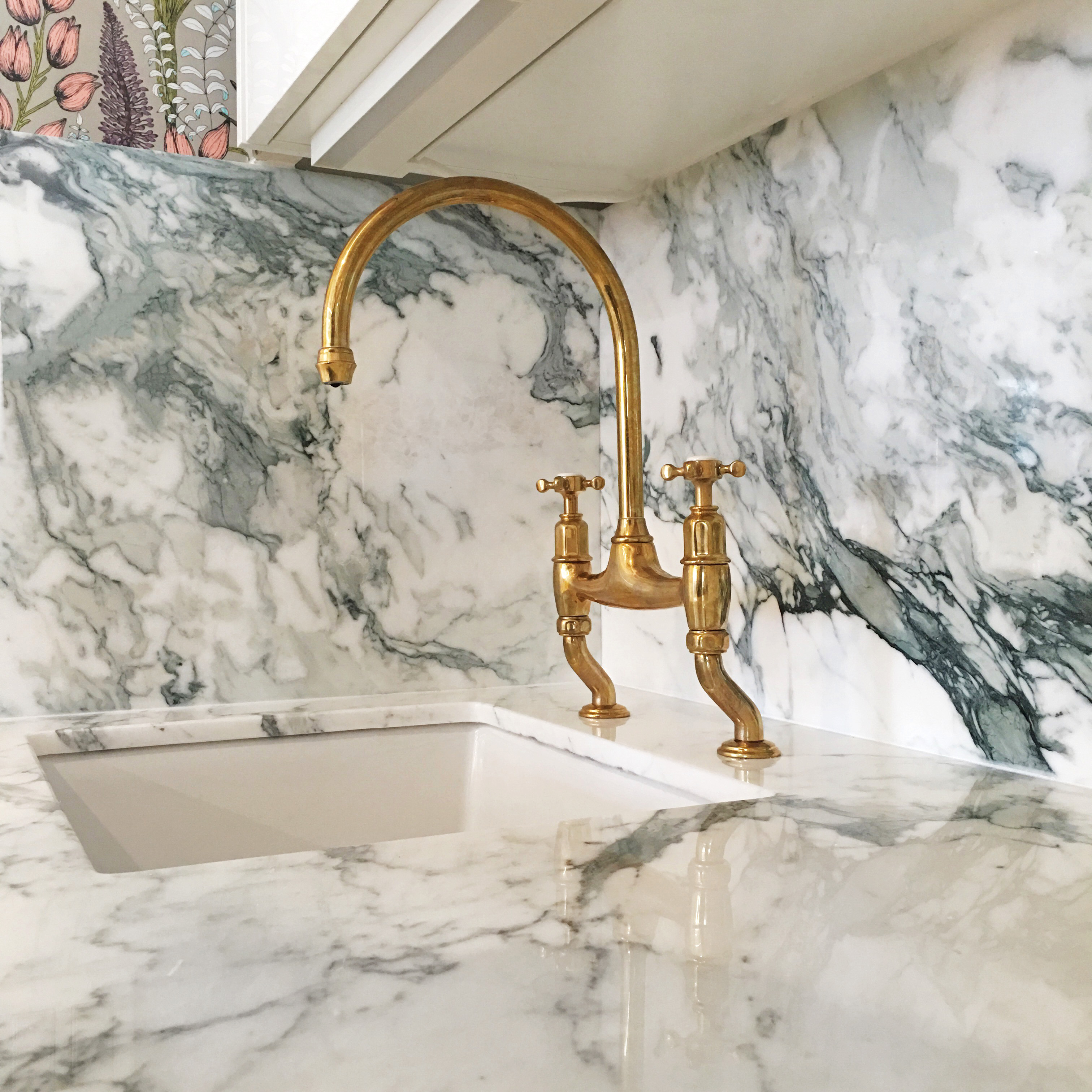 tyson marble sink and metal faucet