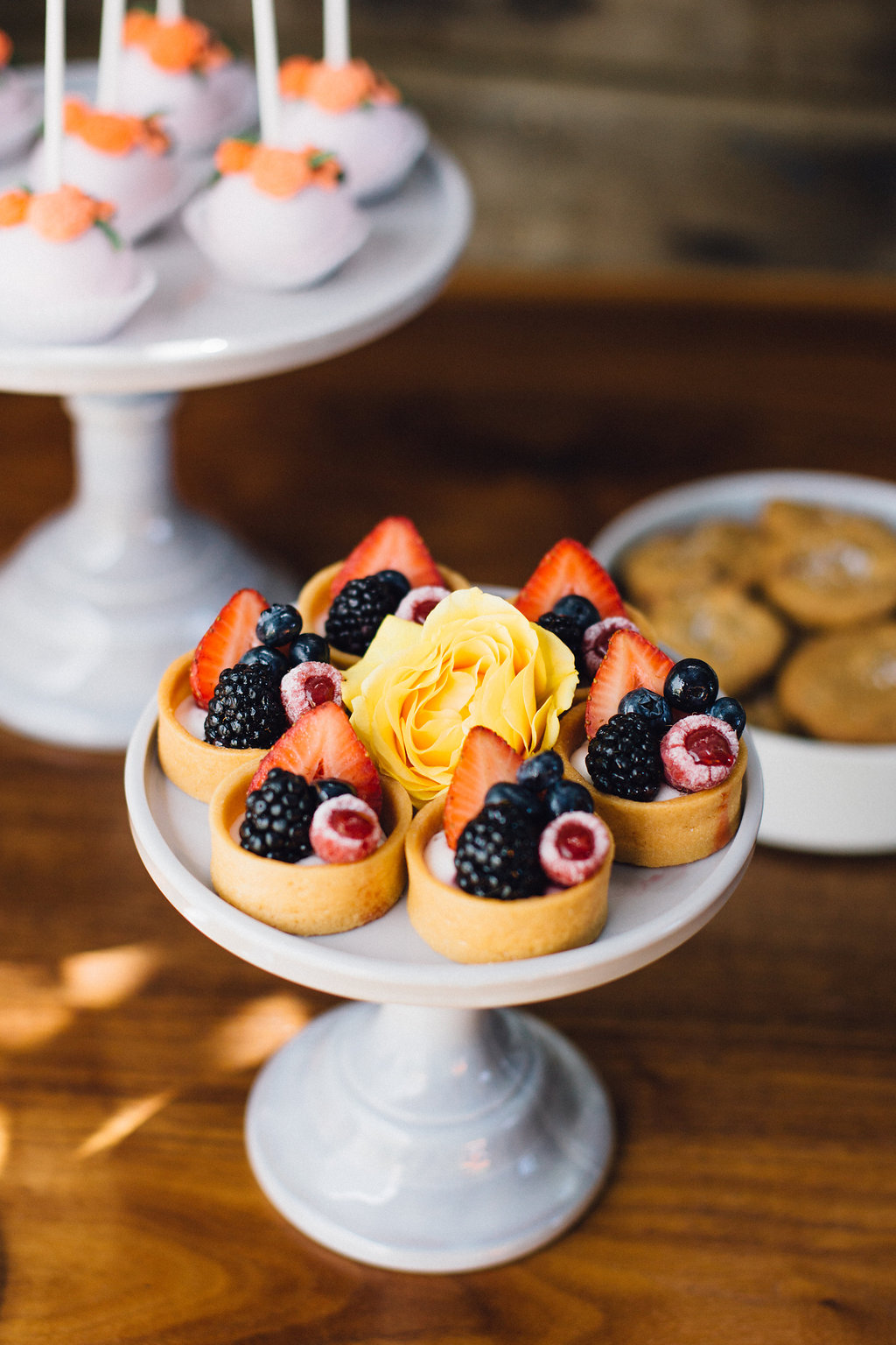 Fruit tarts provide a pop of color to the dessert spread.