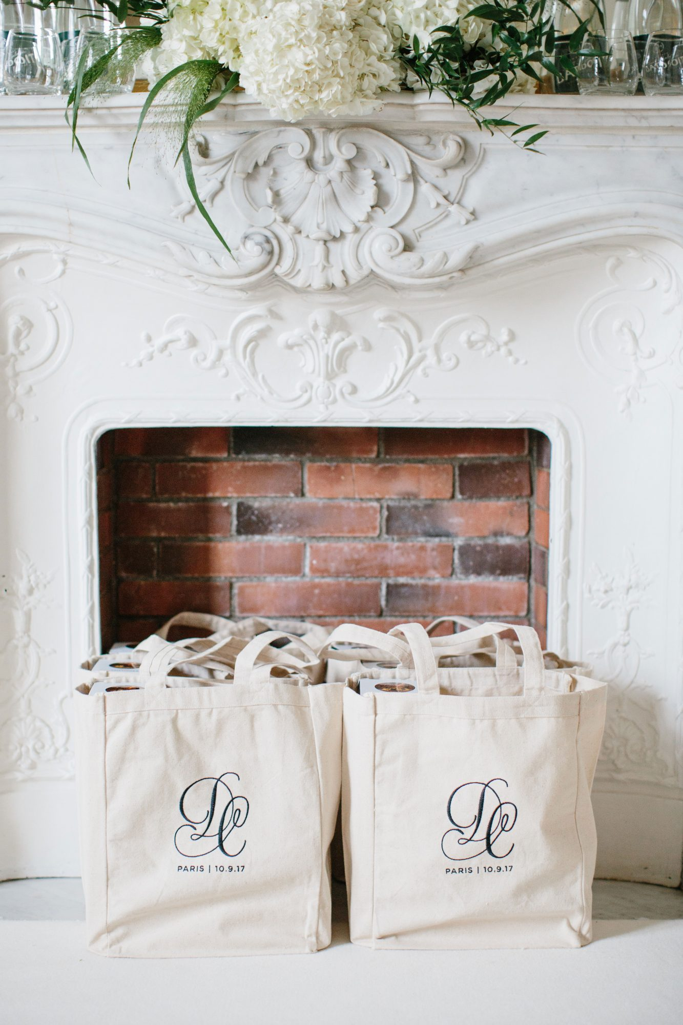 Guests were given welcome bags printed with a logo designed by Kara Anne Paper and stuffed with Sugarfina candy, a few pampering essentials from Primally Pure (one of the bride's favorite brands), an emergency kit, Champagne, Ladurée macarons, a Staub cocotte, and a little book of French phrases.