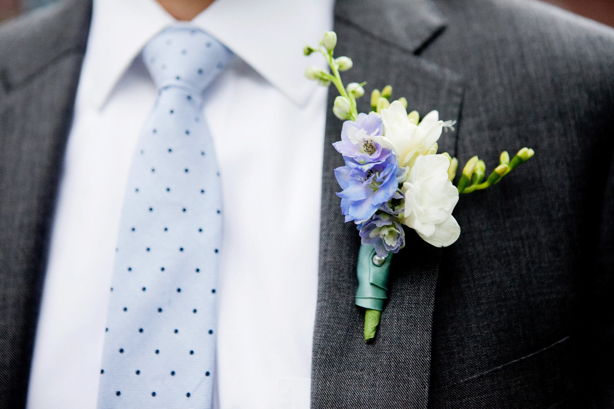 purple white spring boutonniere