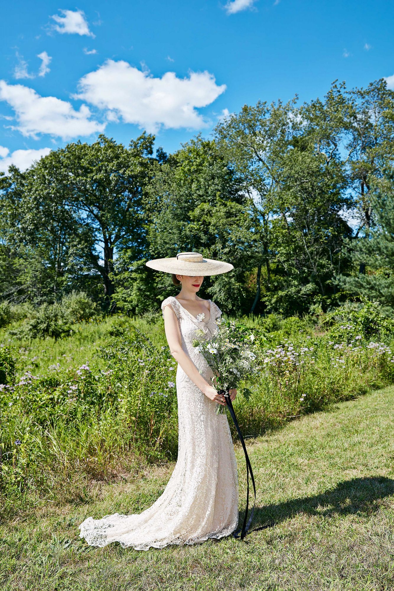 avril quy wedding new york bride hat outdoors