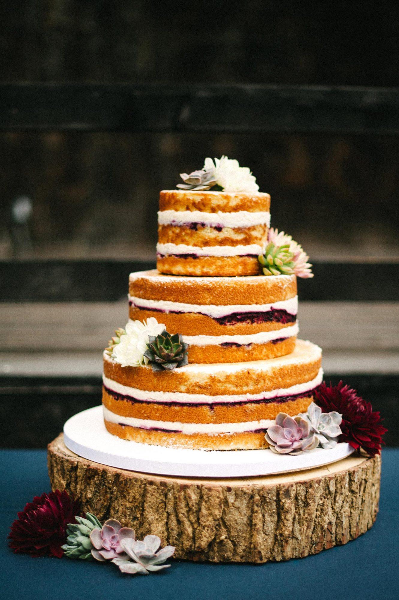 Smilf star Frankie Shaw's raspberry-and-cream-filled naked wedding cake (complete with a gluten-free top tier!) was decked out in succulents. Fleur de Lisa made the dessert.