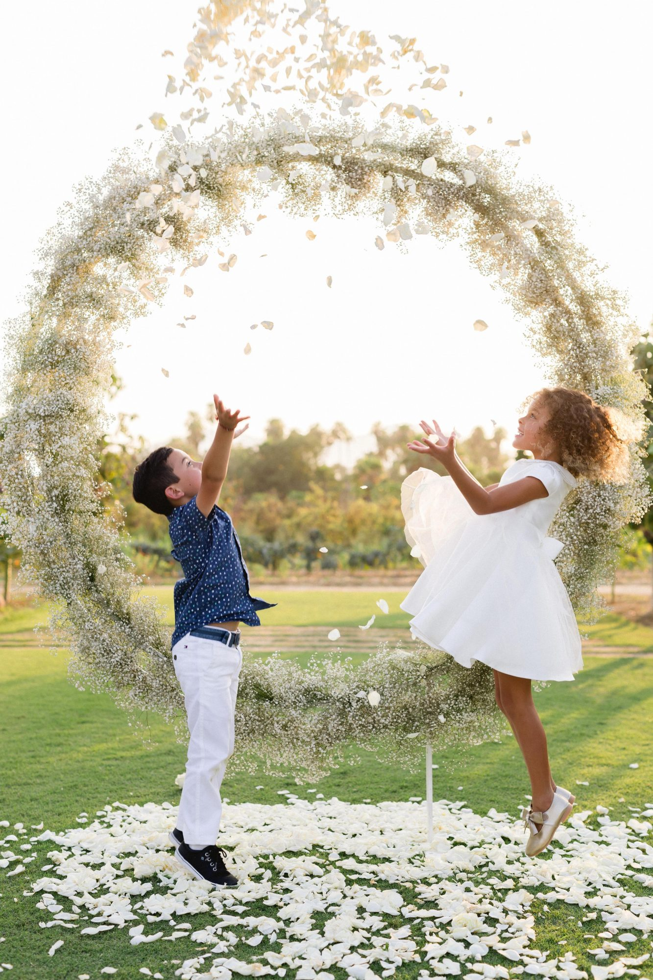 brittany craig wedding kids playing in petals