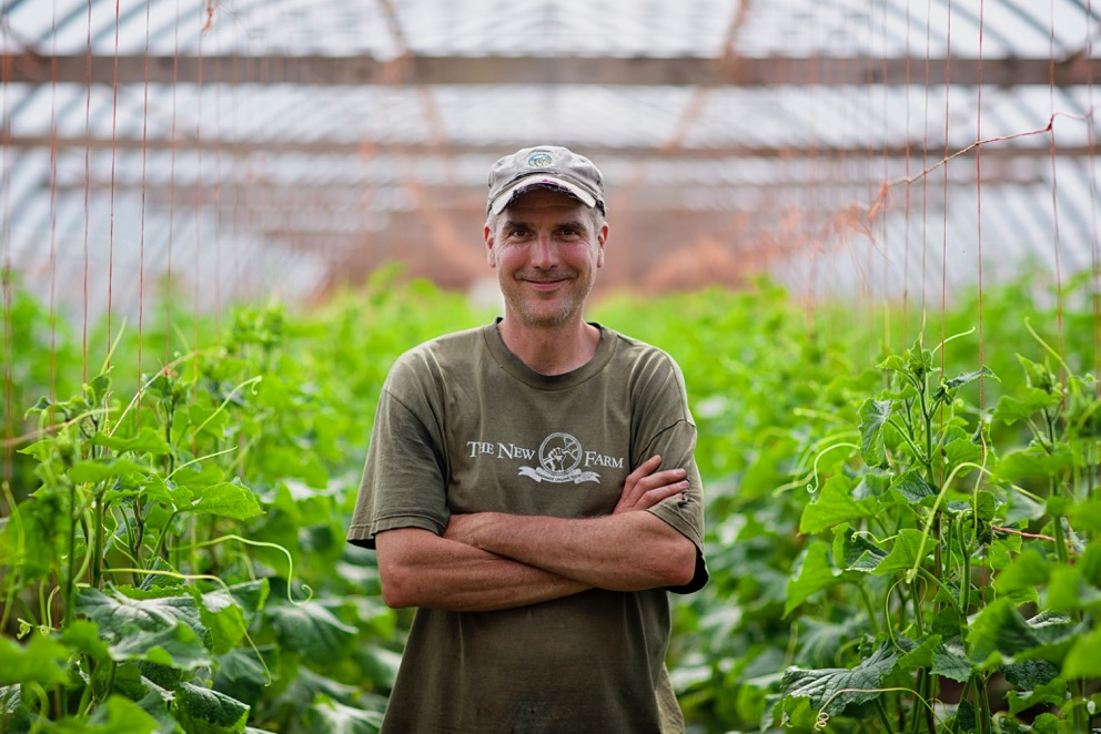 Brent Preston standing in front of a crop.