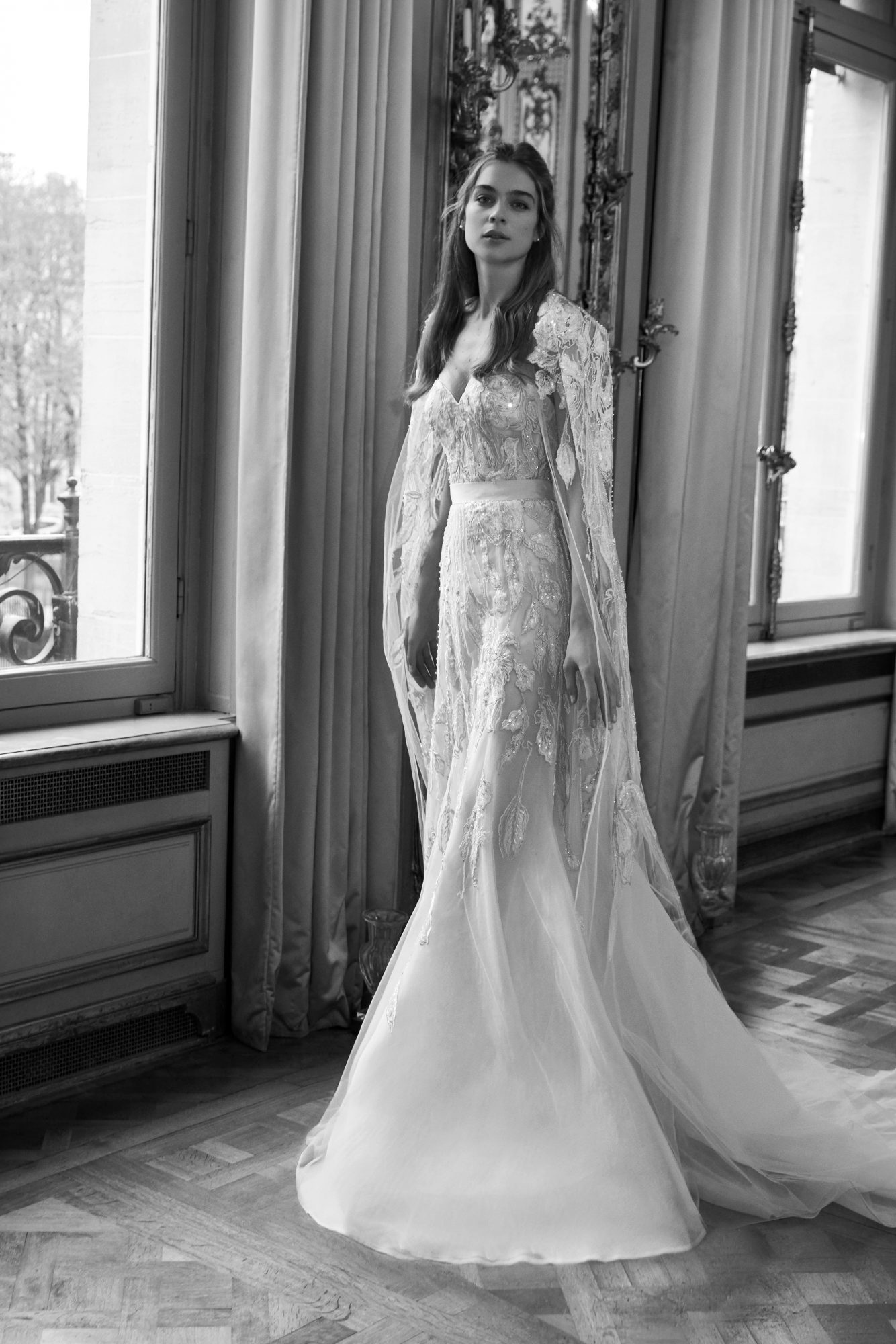 Strapless mermaid wedding dress with sweetheart neckline, appliqués throughout, and cape