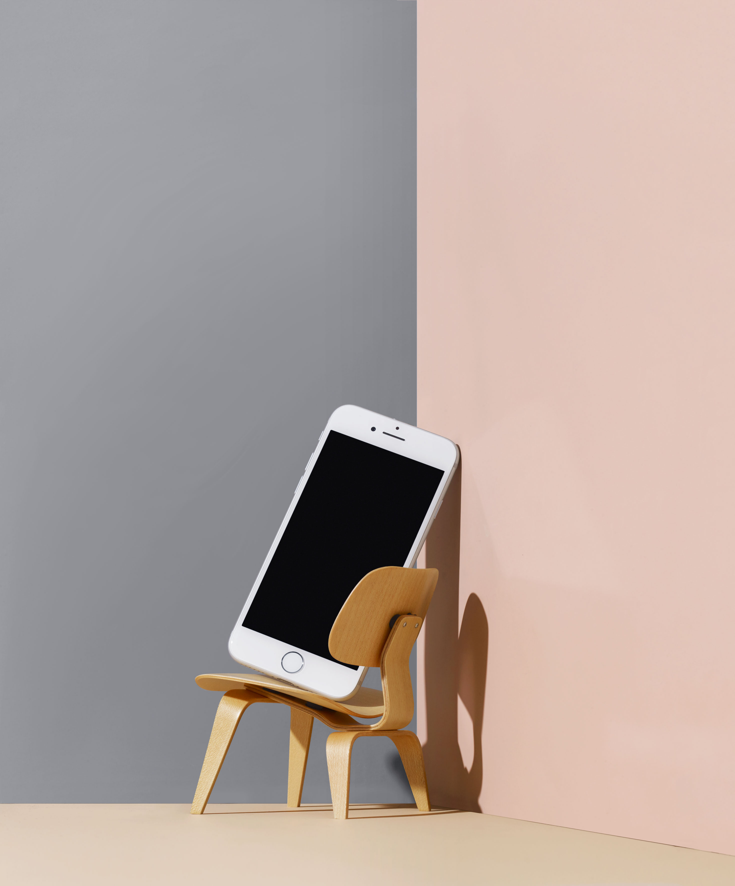 iphone on little wooden chair