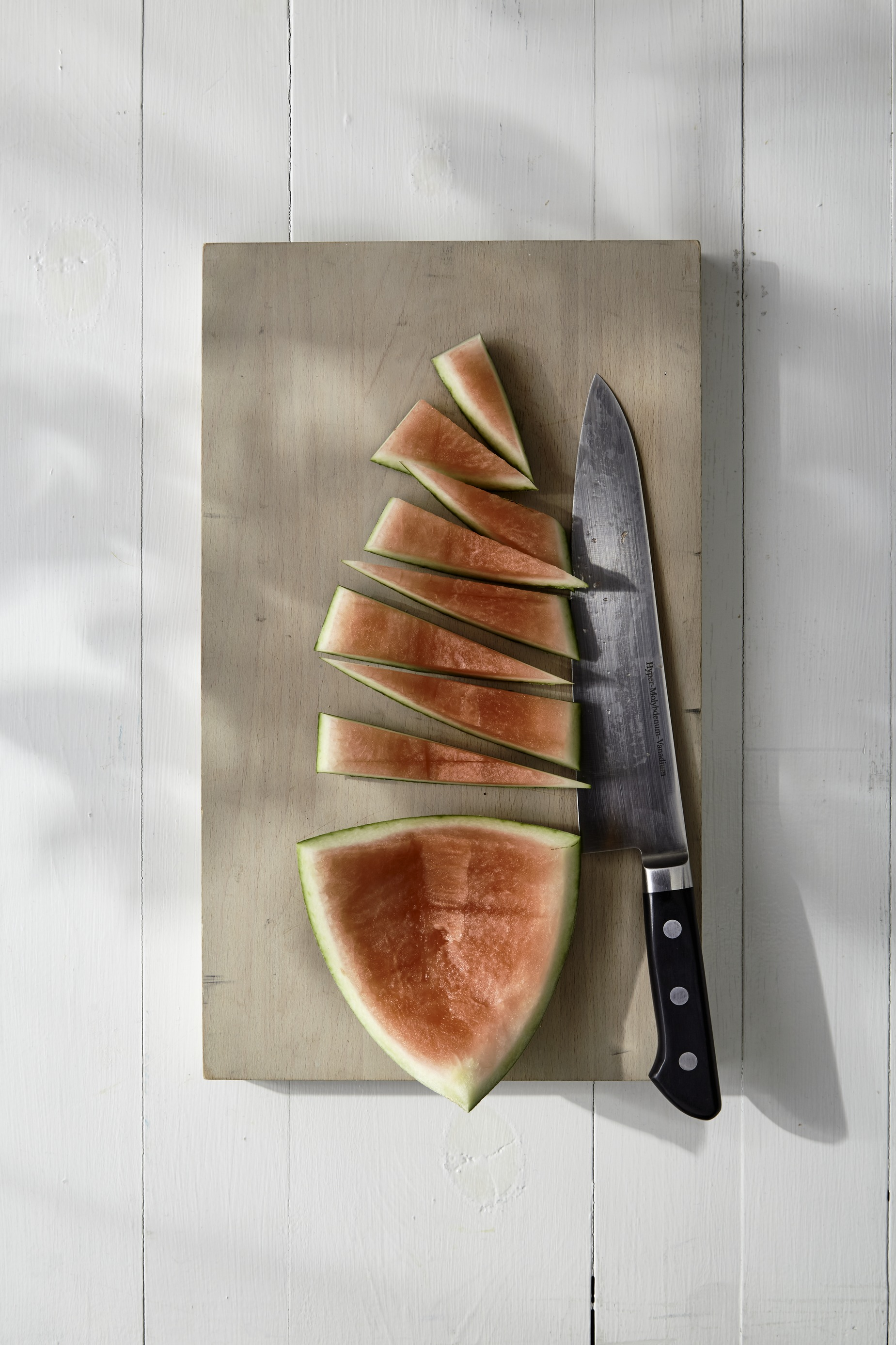 cutting up watermelon rind