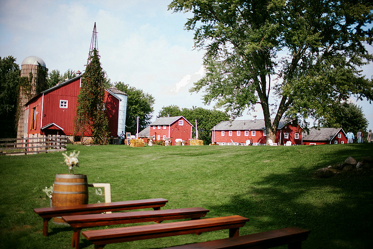 new venue outdoor red barn ceremony seating