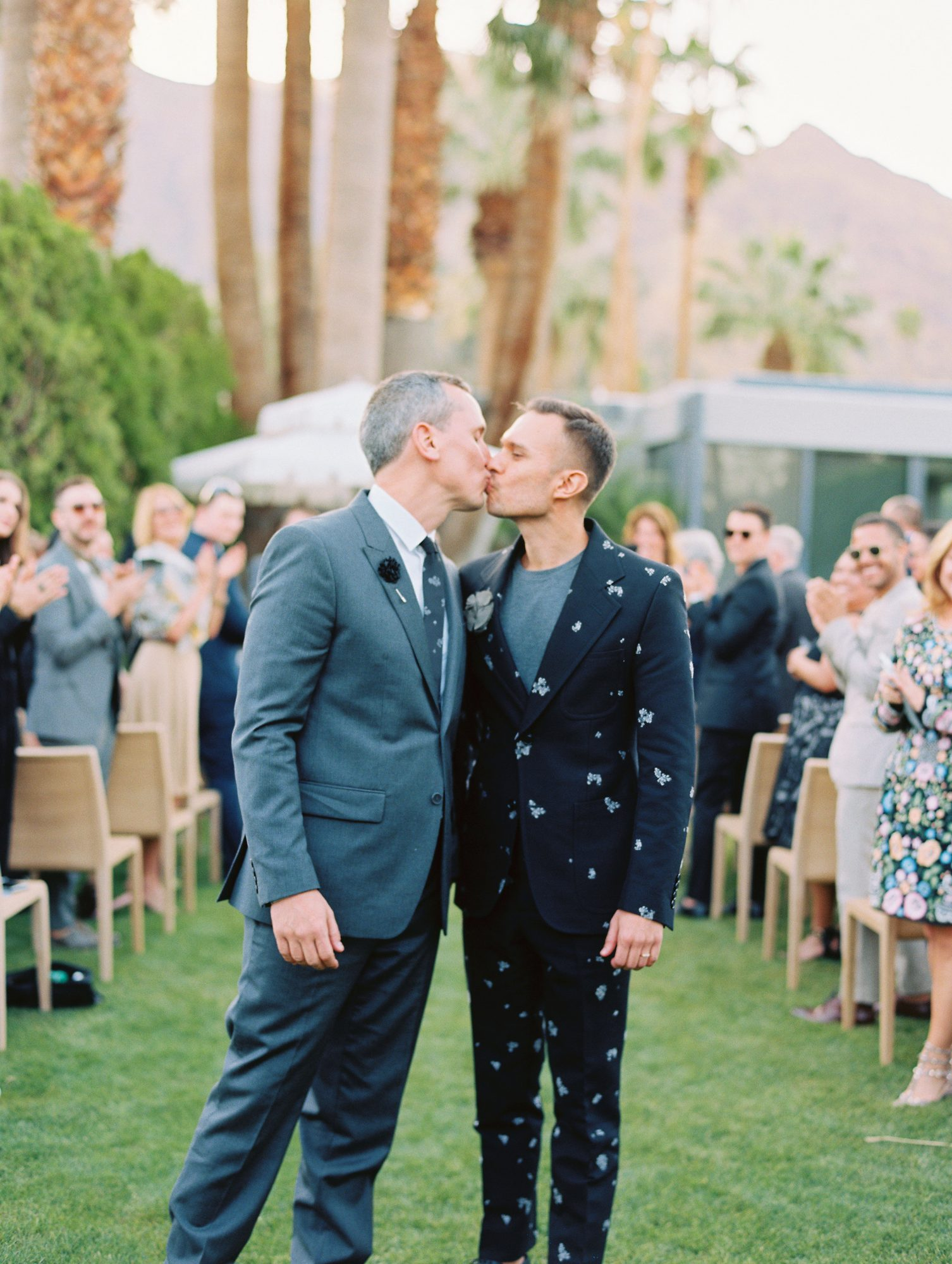 The groom on the right looked dapper in an Alexander McQueen suit, which was finished with a fabric flower by Lanvin on his lapel.