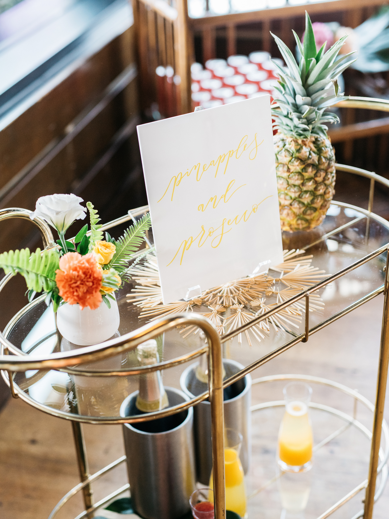 pineapples and prosecco bar cart