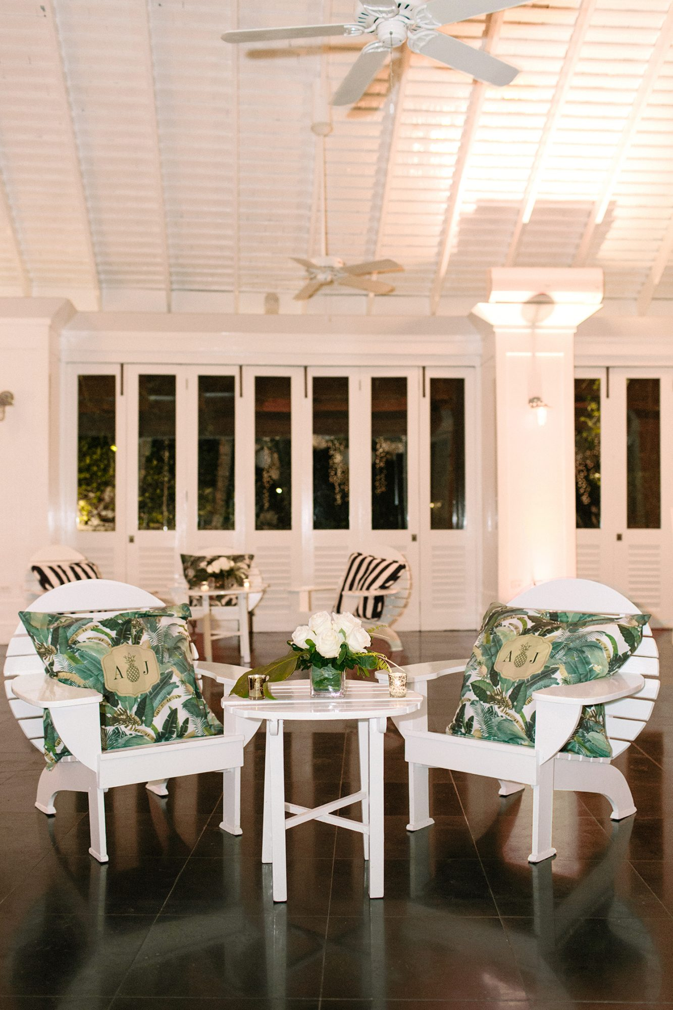 abbey jeffrey wedding lounge with tropical pillows