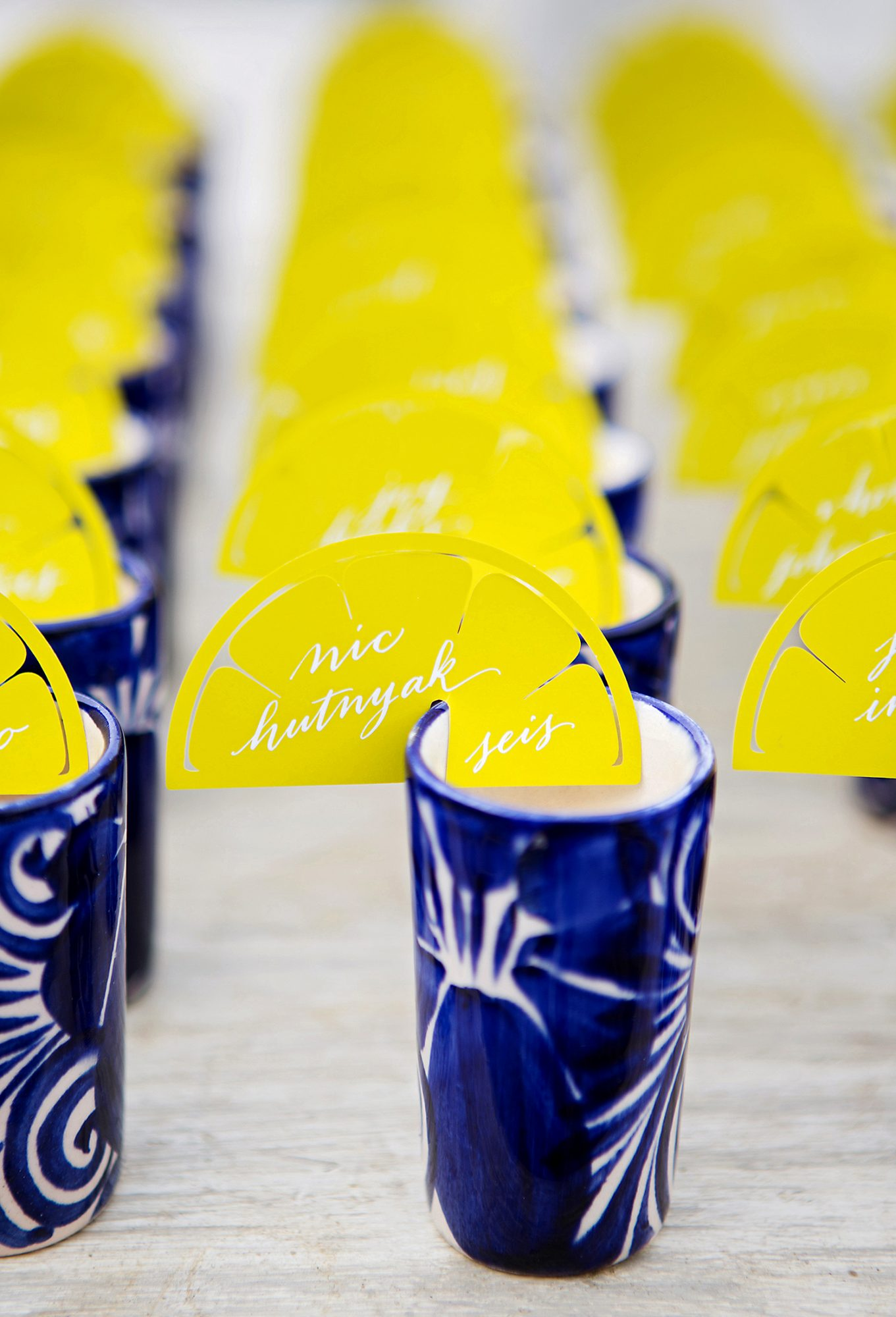 alcohol escort cards calligraphed lemon cards on glasses