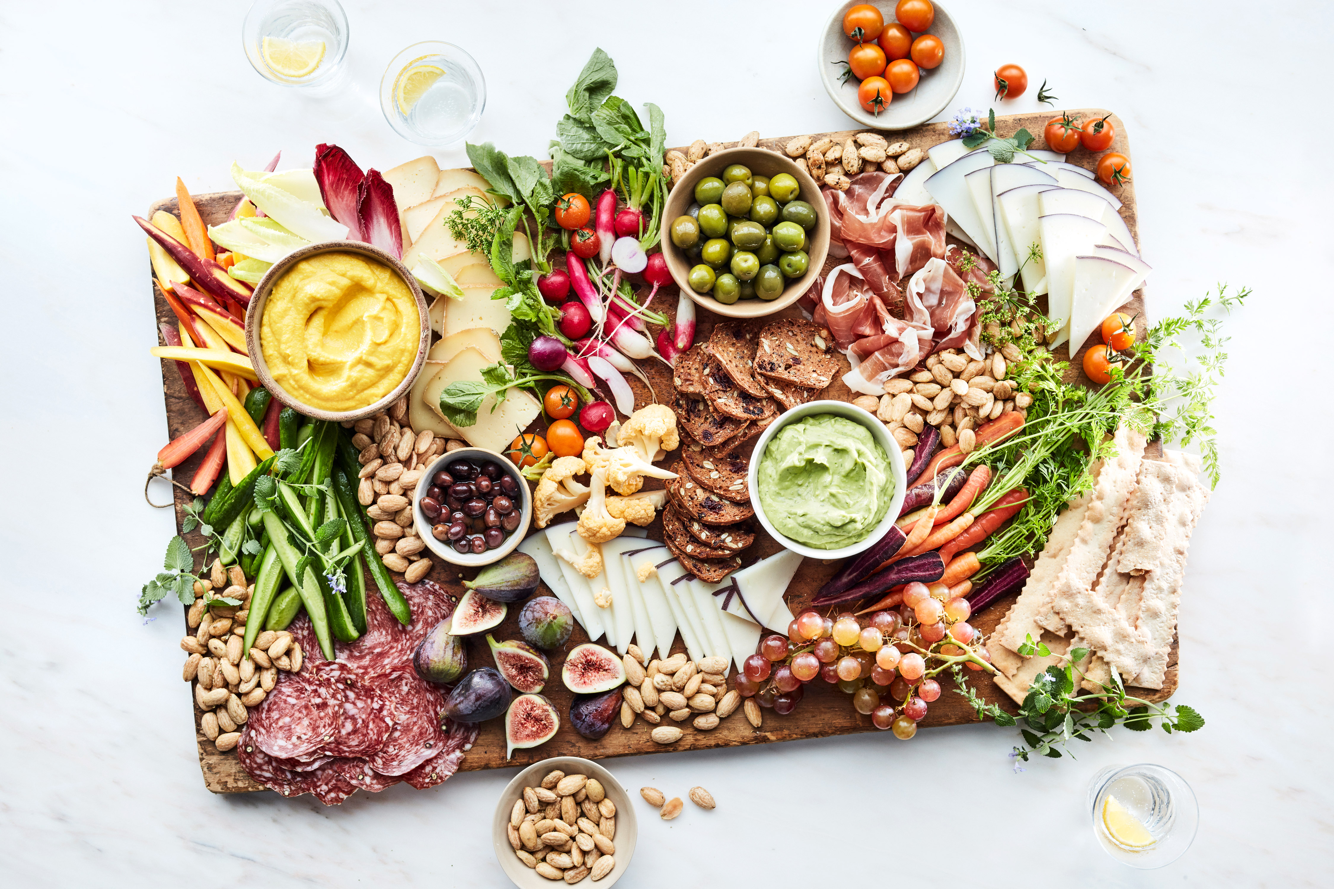 grazing board summer step 6 meats vegetables dips cheese bread wooden