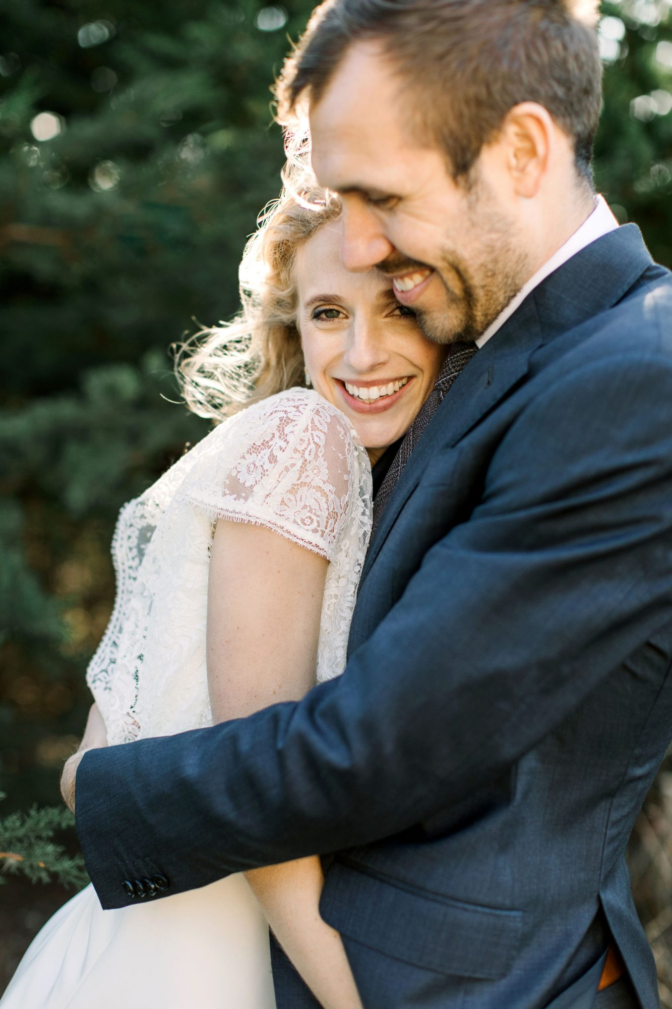 gillian marcus wedding couple smile embrace