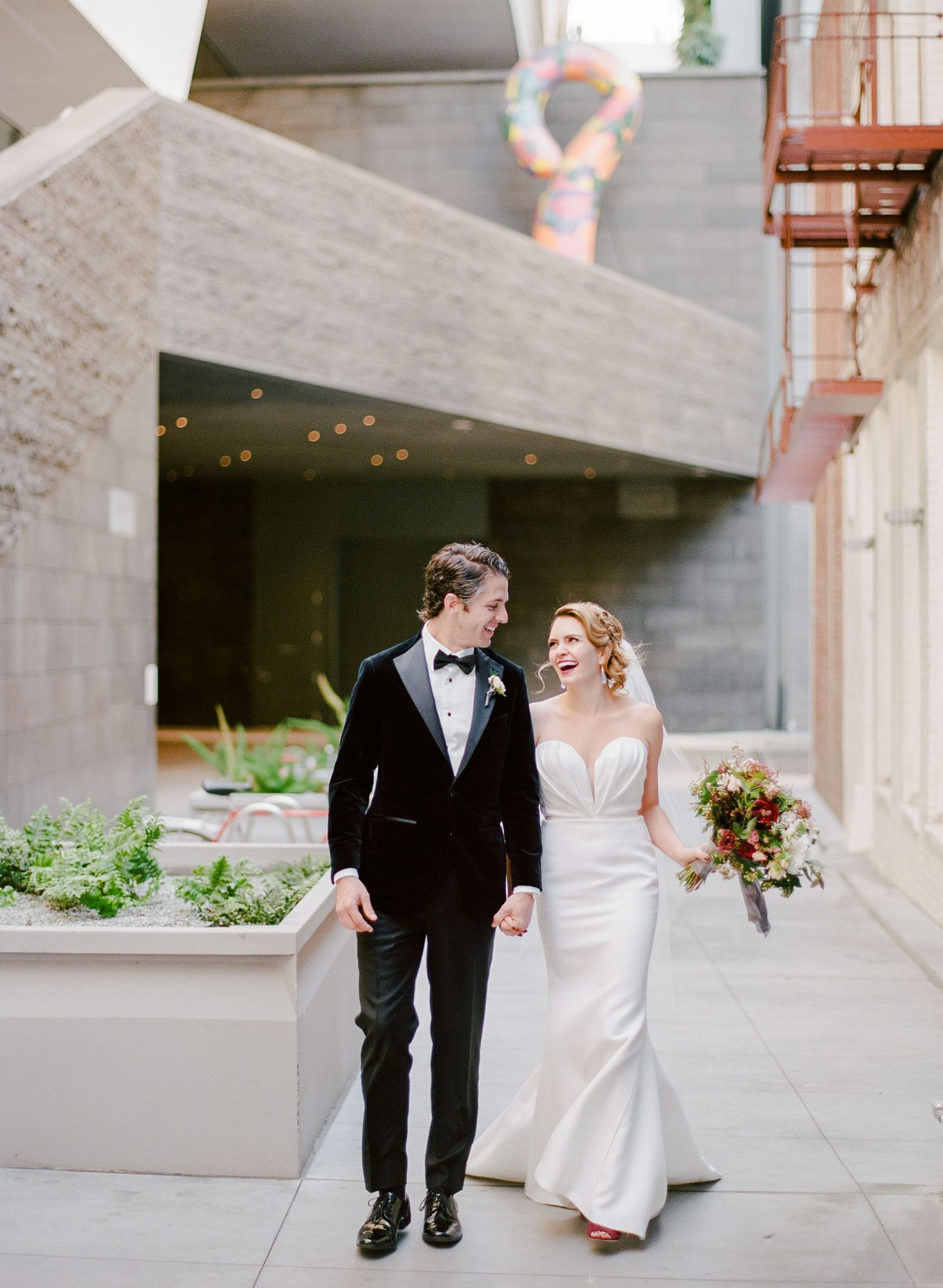 katie andre wedding couple walking laughing