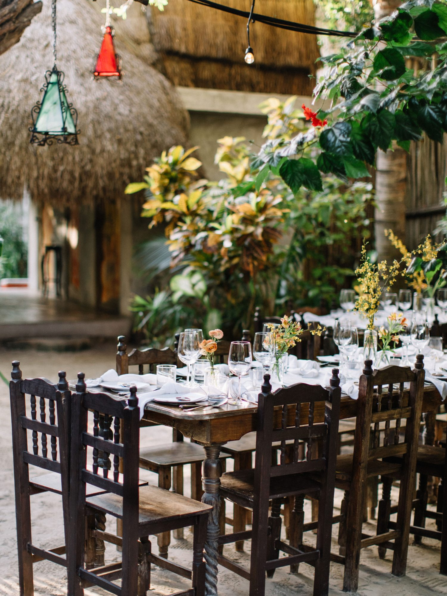 ariel trevor rehearsal dinner tulum mexico wooden table place setting