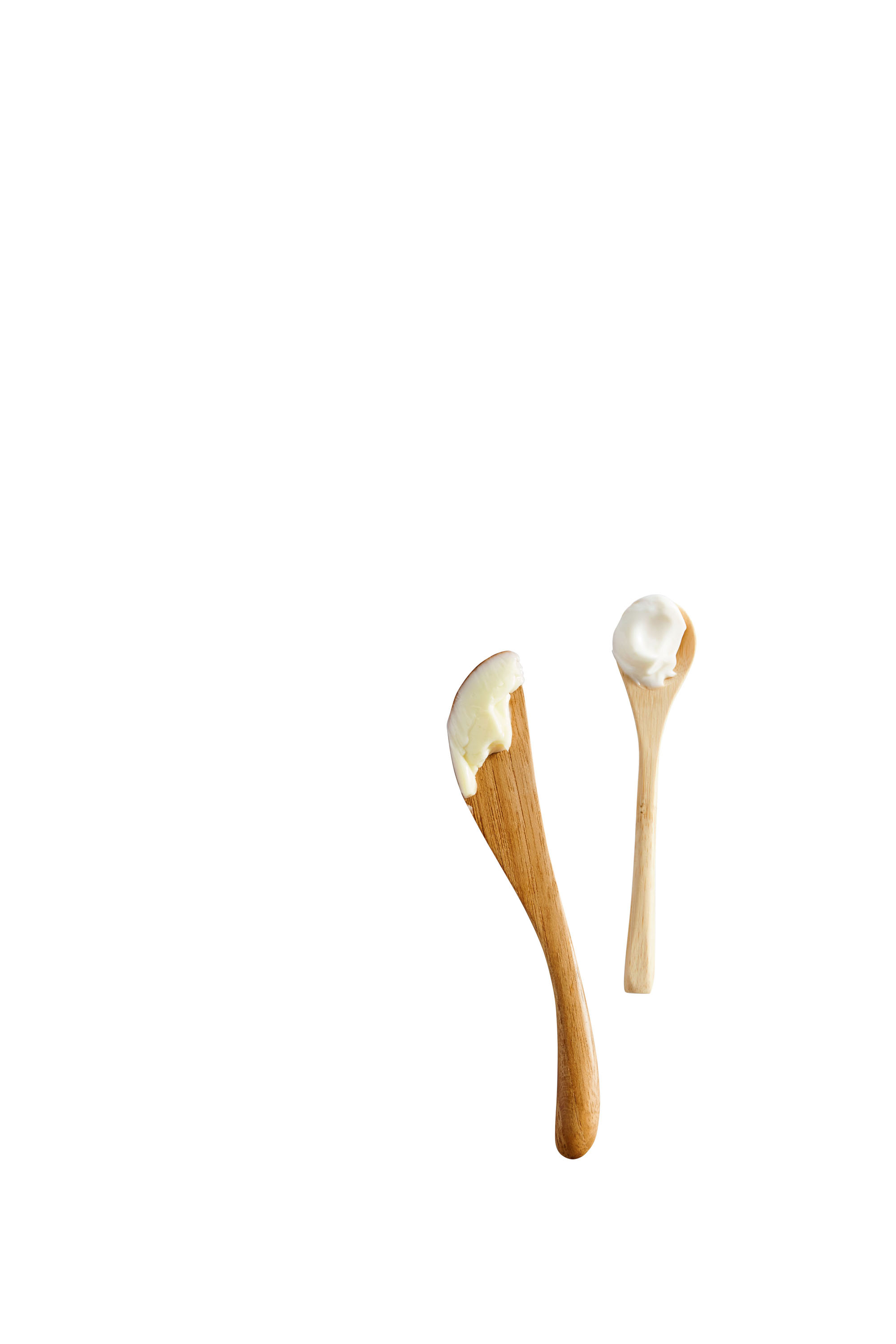 wooden spoons with butter