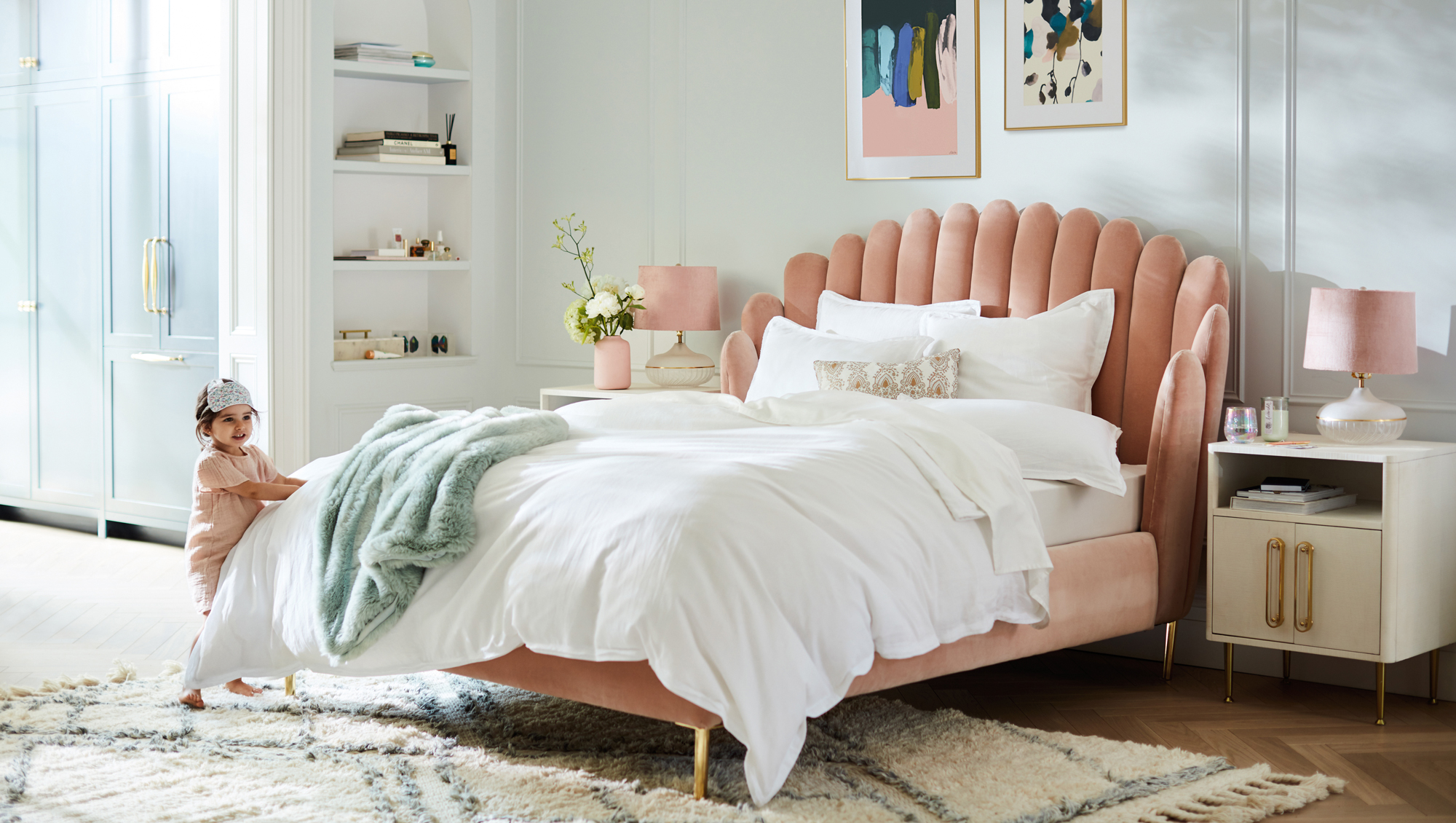 pink plush bed with child