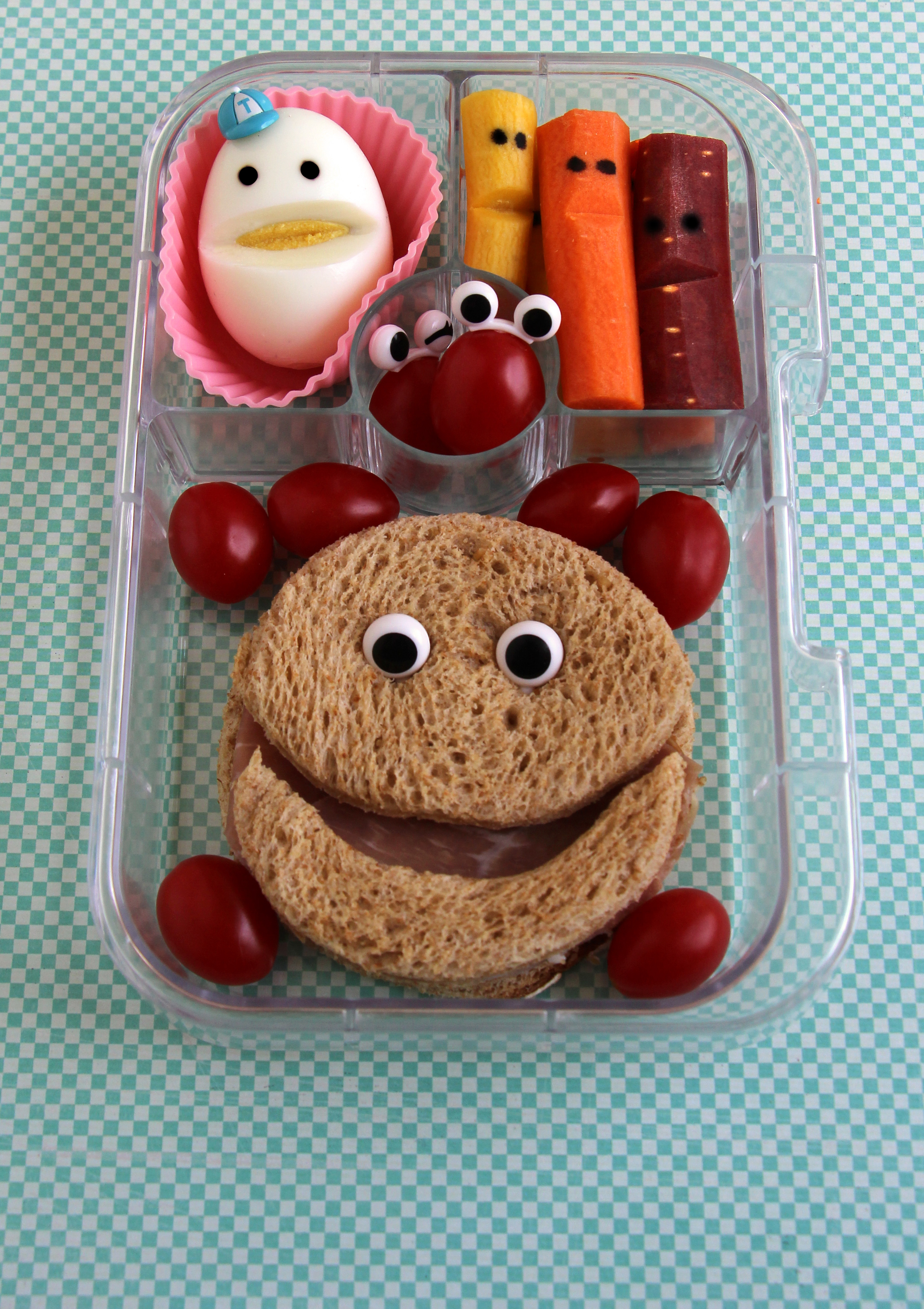 bento box silly faces egg sandwich eyes grapes
