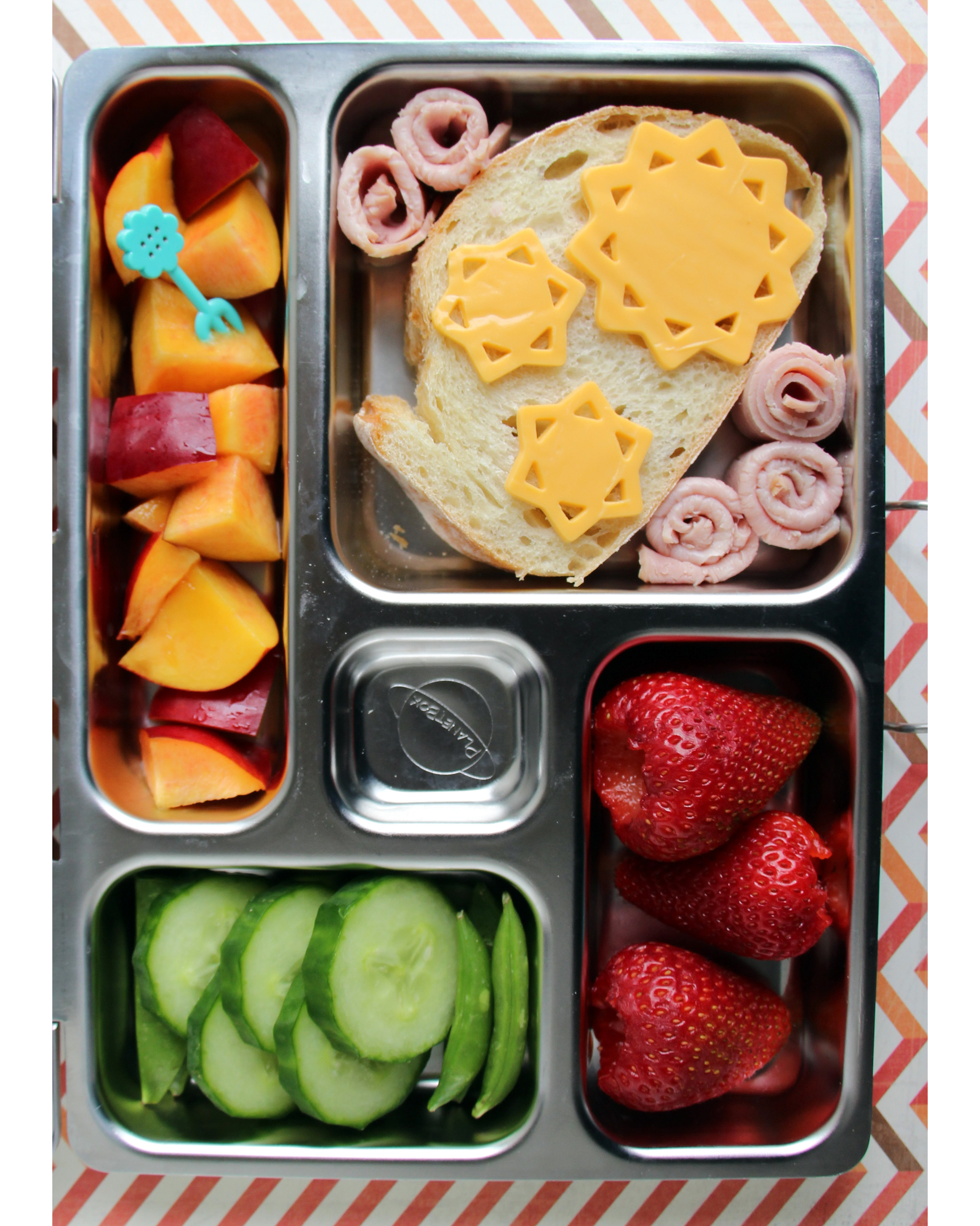 bento box strawberries cucumbers sandwich cheese sunshine