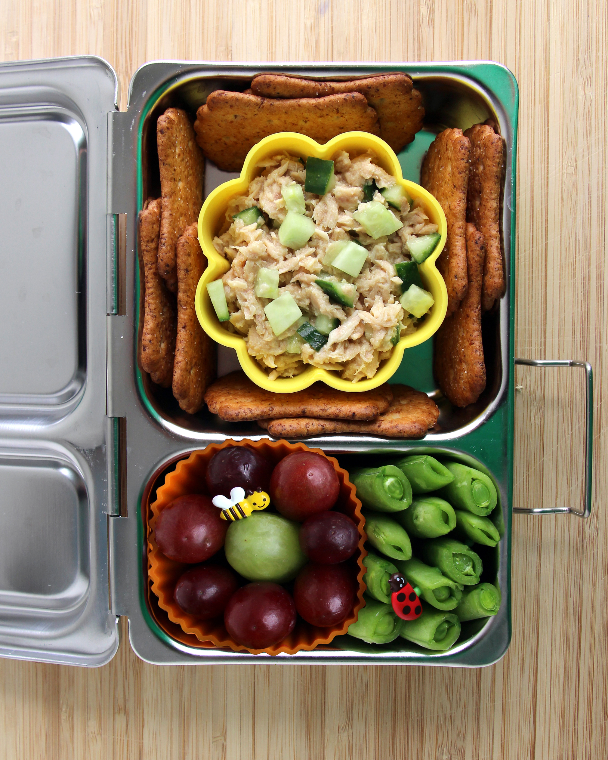 bento box tuna flower peas grapes