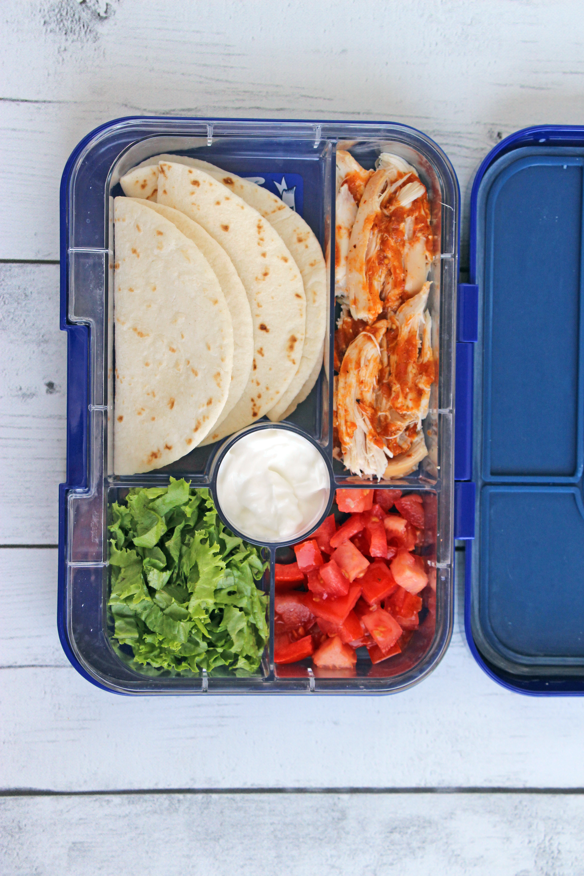 bento box chicken tacos lettuce sour cream